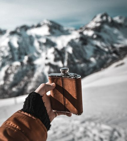 Hip flask of Whisky in the french alps