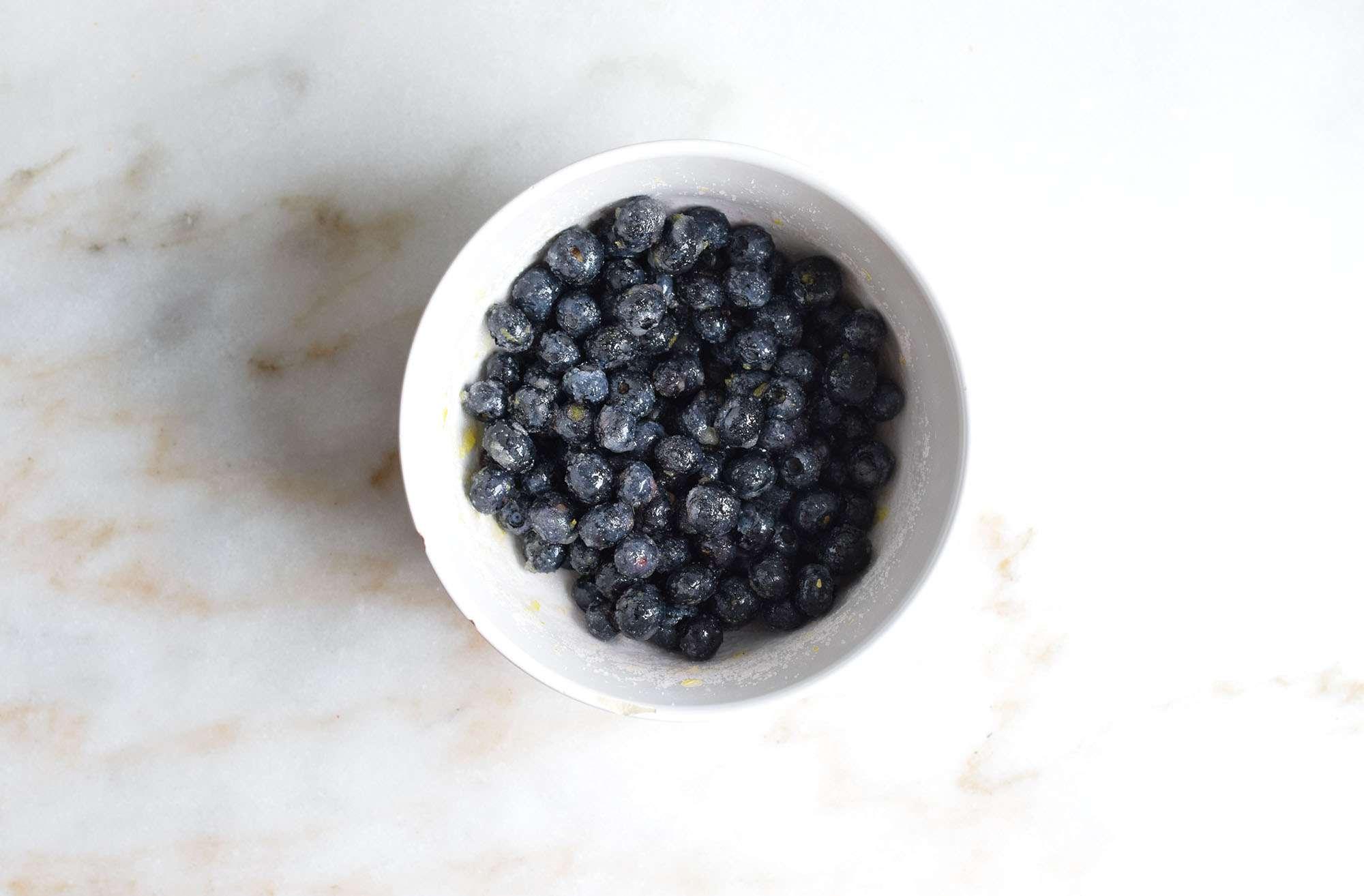 blueberries tossed with lemon zest, lemon juice, and sugar