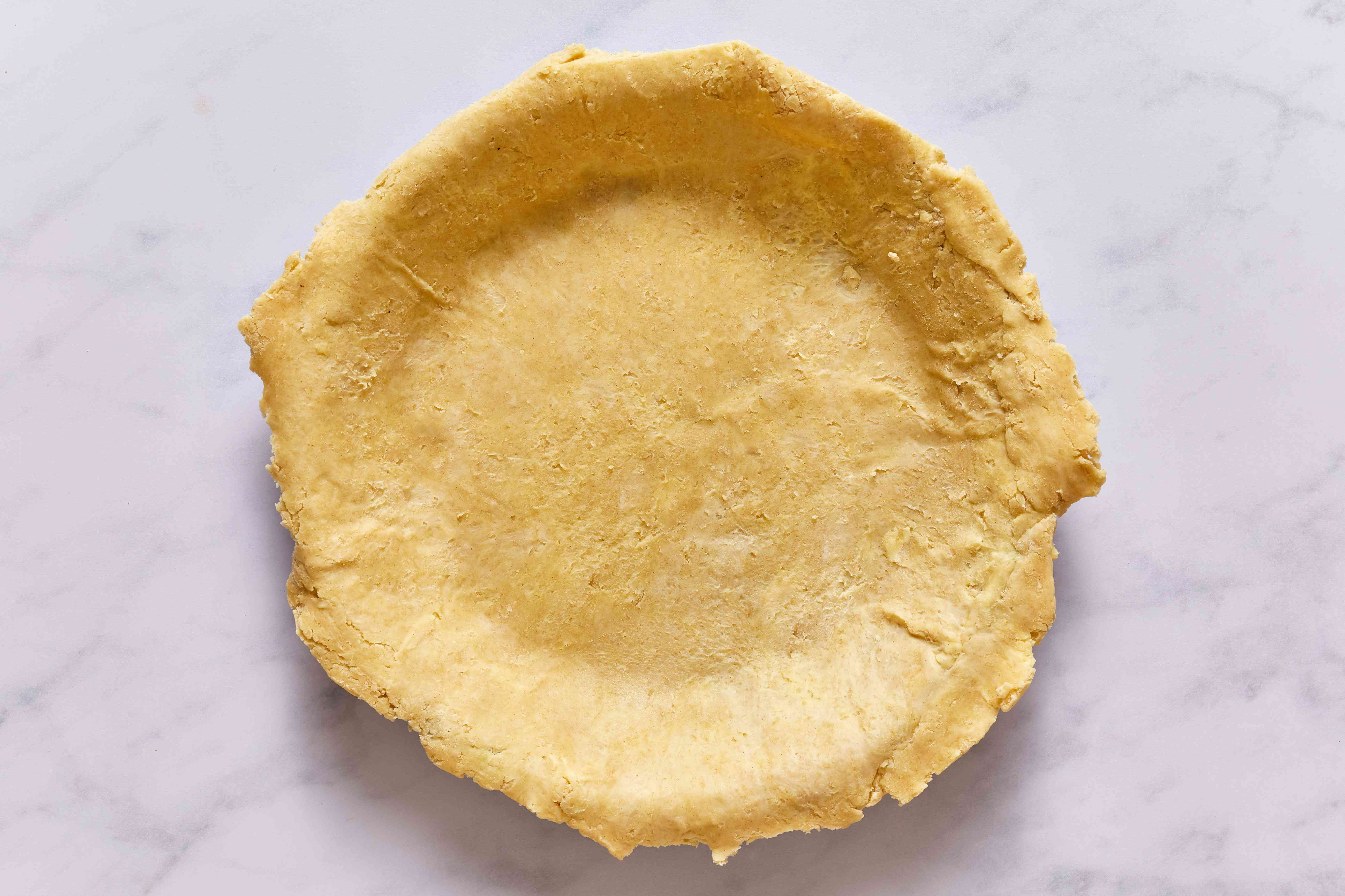 pie dish lined with pastry dough