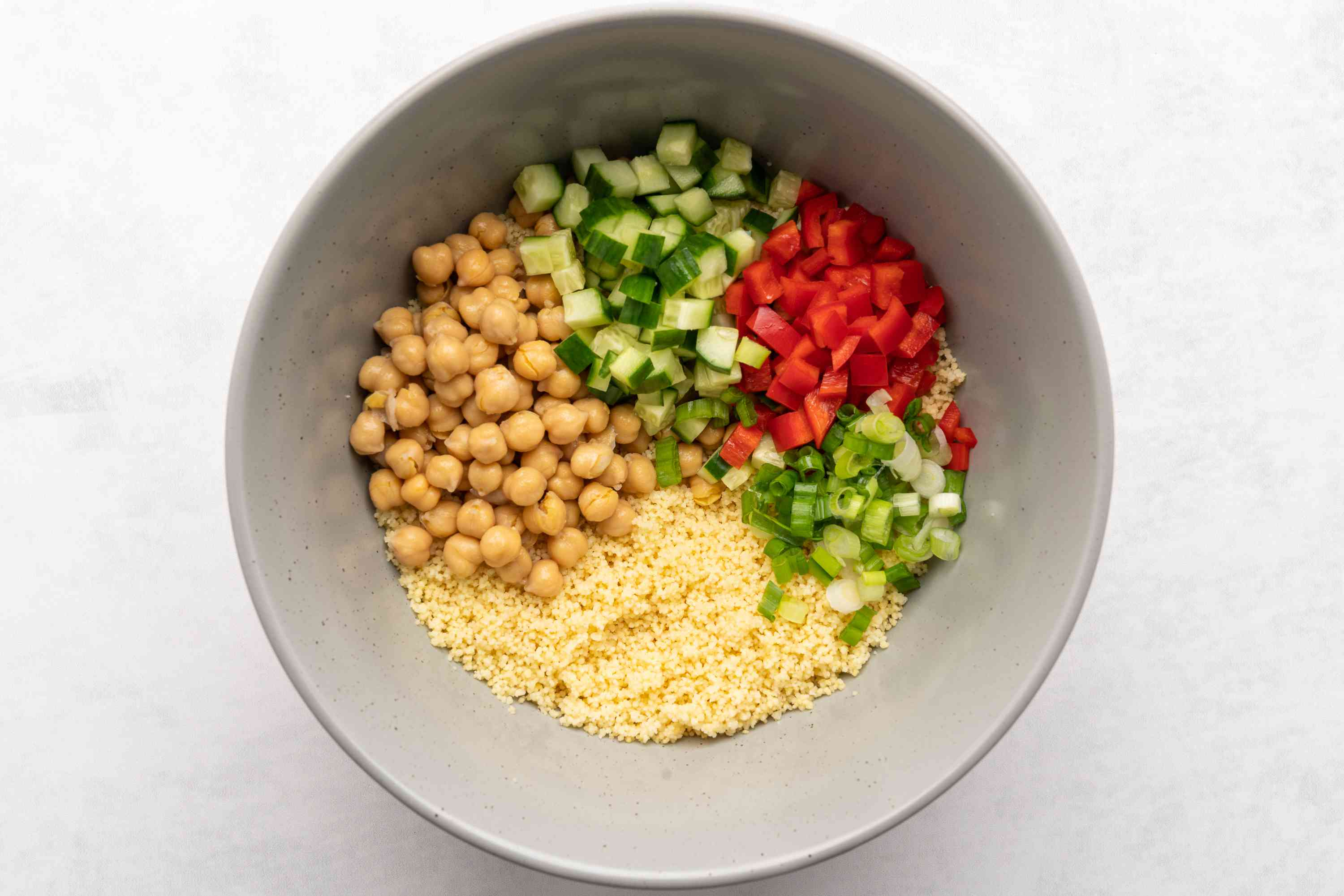 couscous salad ingredients in a bowl