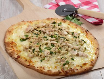New Haven white clam apizza on a pizza peel