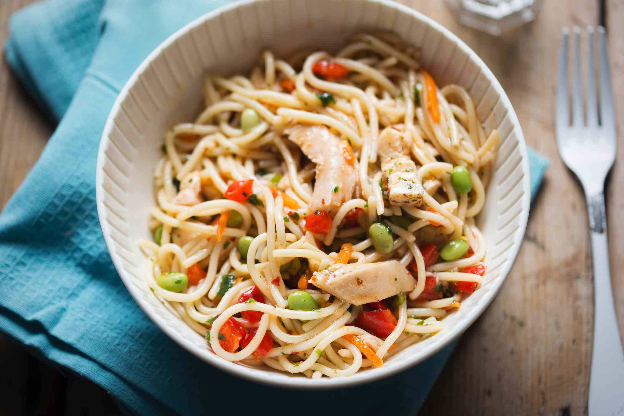 Sweet chilli chicken pasta salad with edamame and red peppers