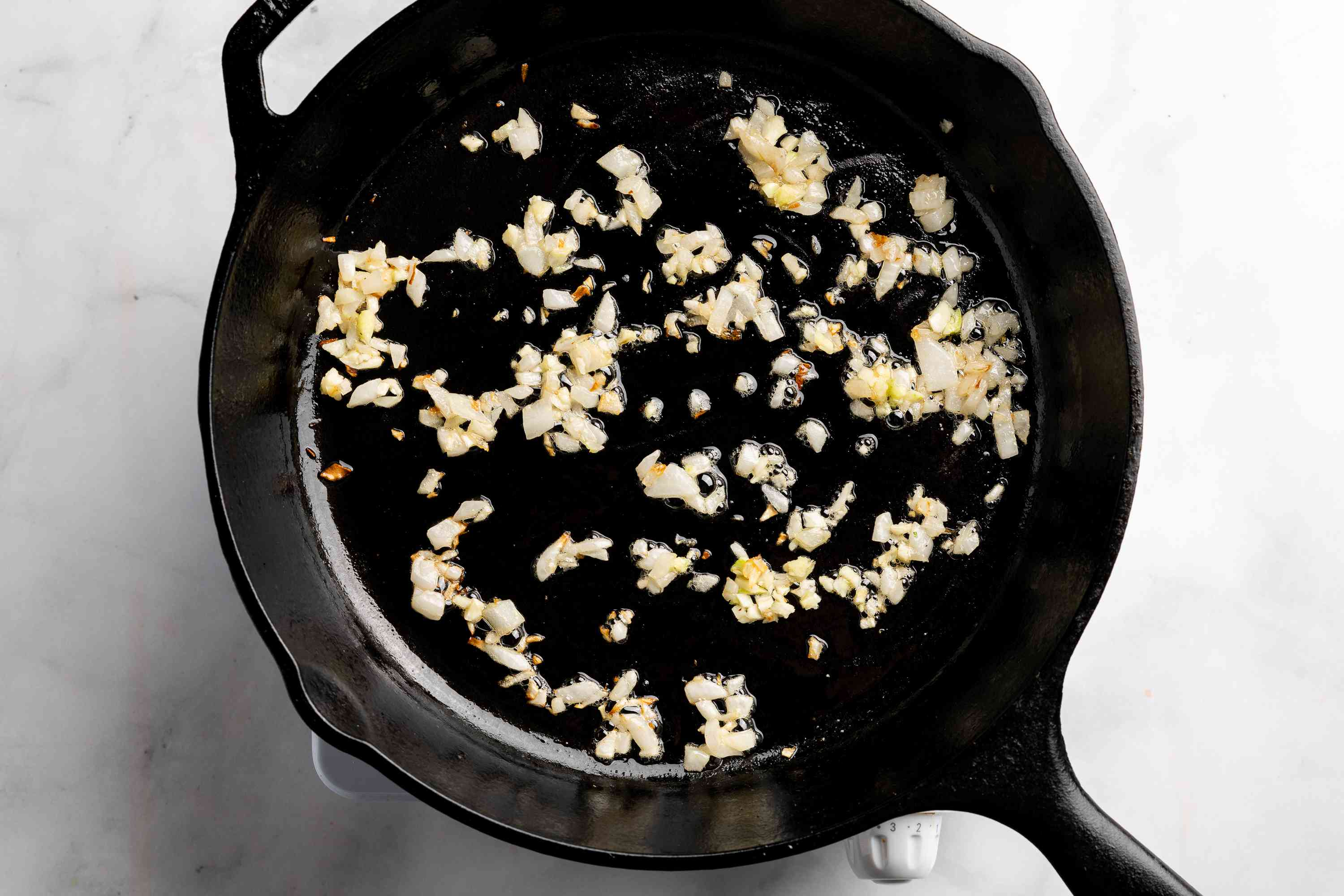 onions and garlic cooking in a skillet