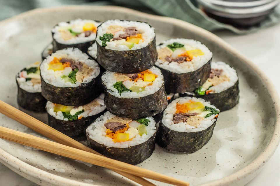 Kimbap (Korean sushi rolls) on a plate with chopsticks