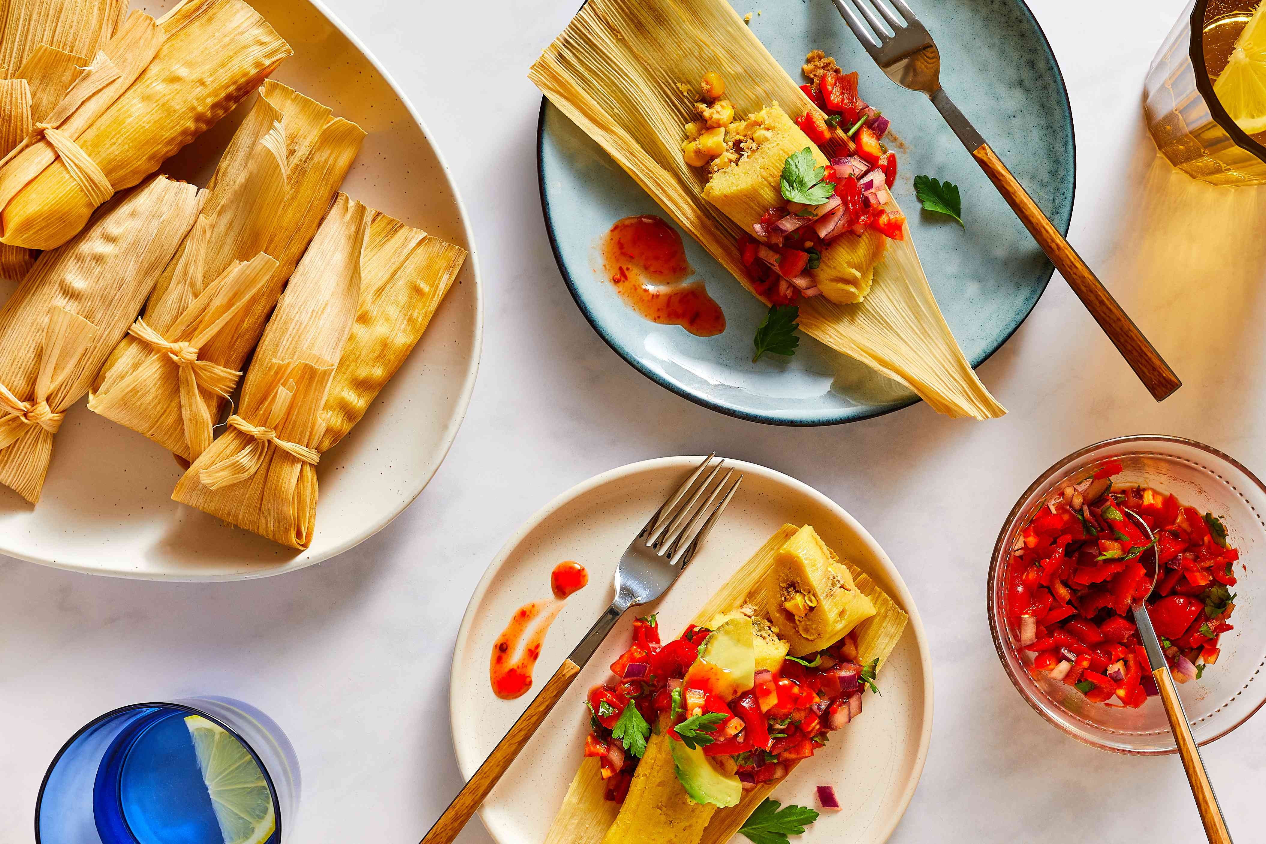 Corn, Green Chile, and Cheese Tamales, served on plates with pico de gallo