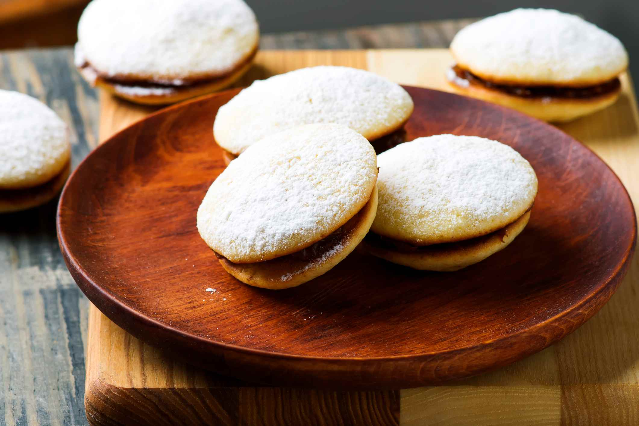 Alfajores on a wooden plate