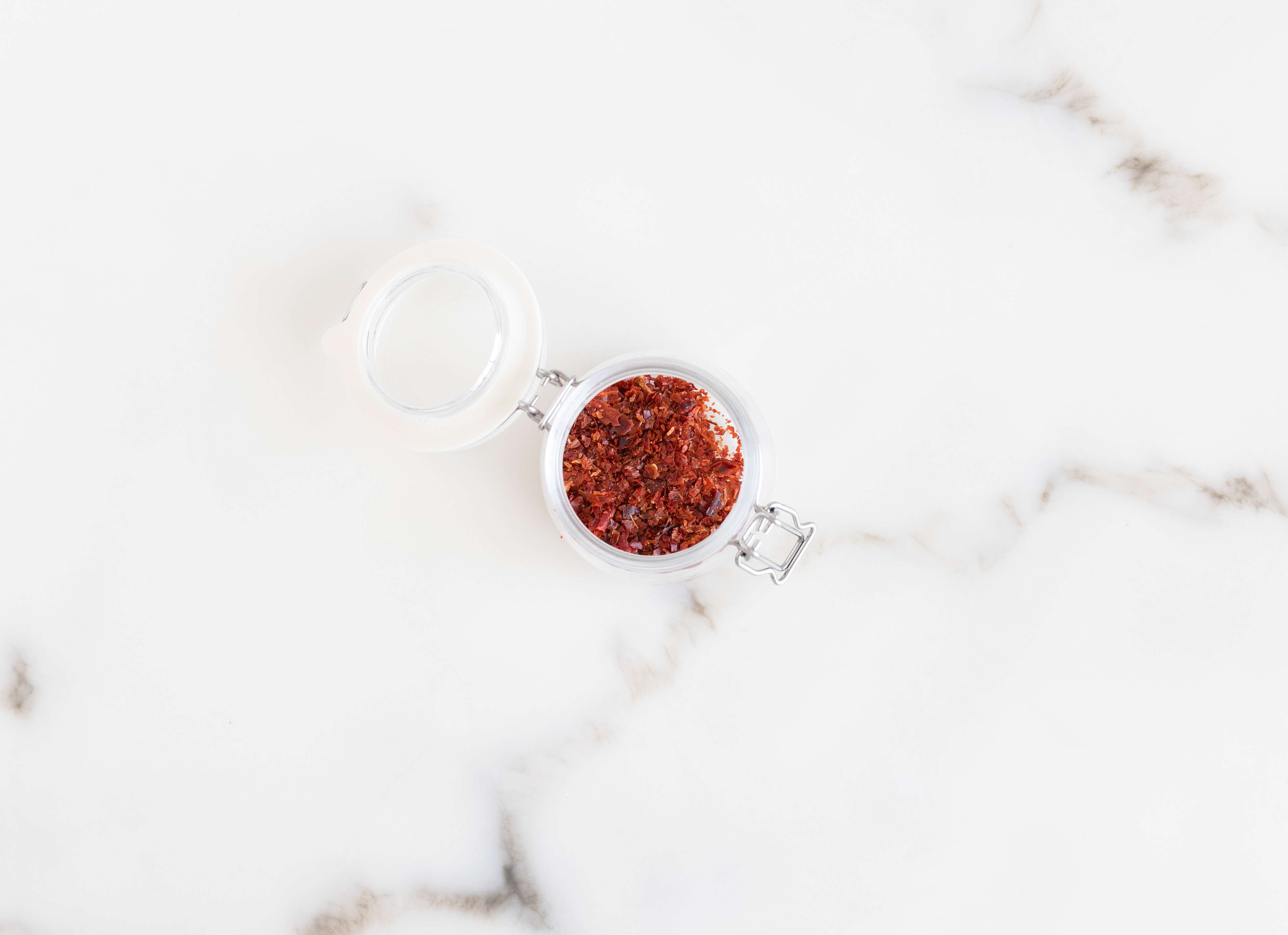 Place the chilies in a jar