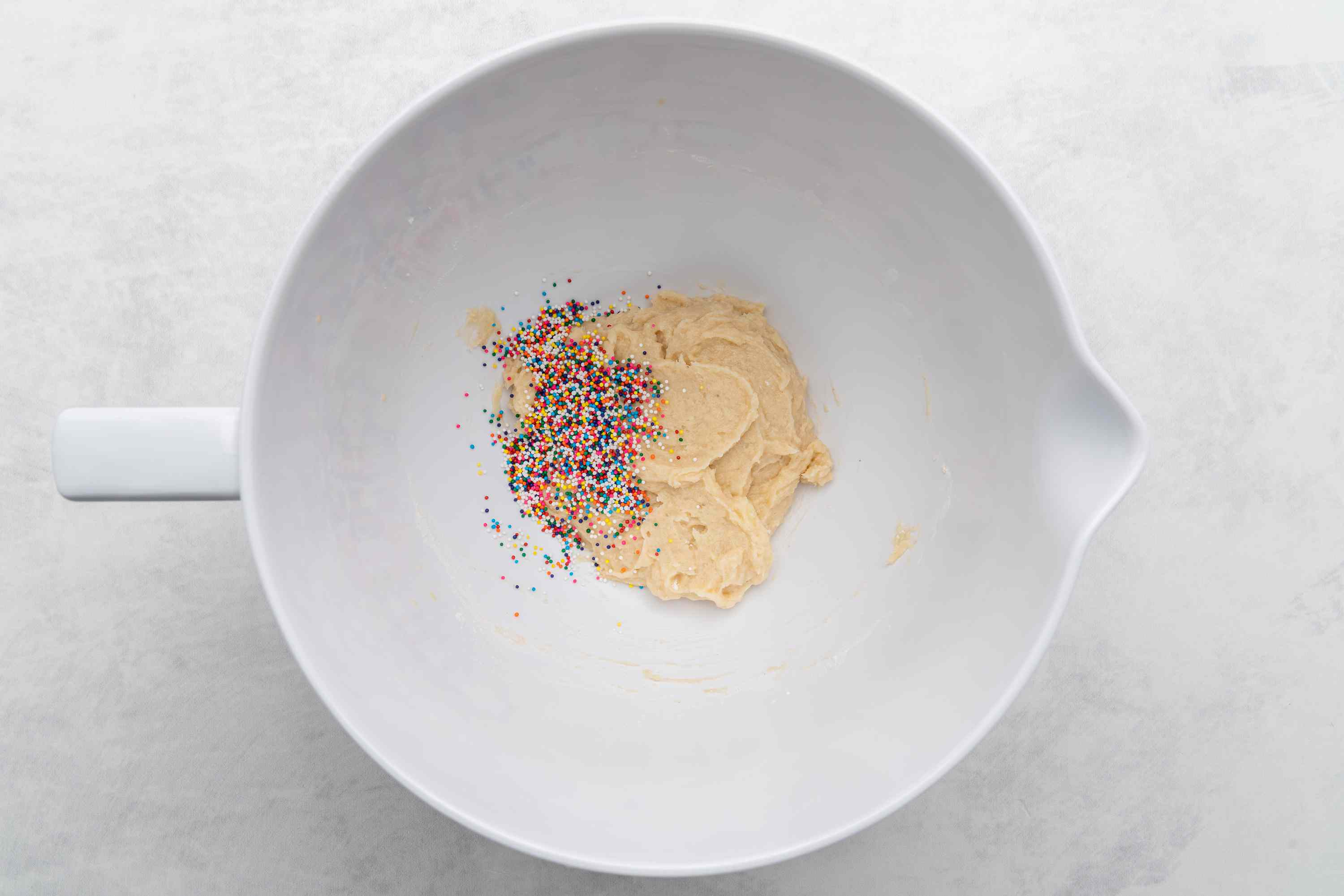 dough in bowl with sprinkles