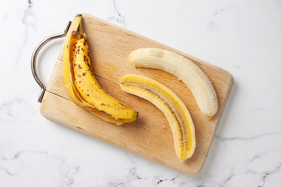 banana split open on cutting board