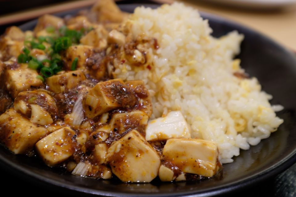 Close-Up Of Fried Rice With Mapo Doufu On Plate