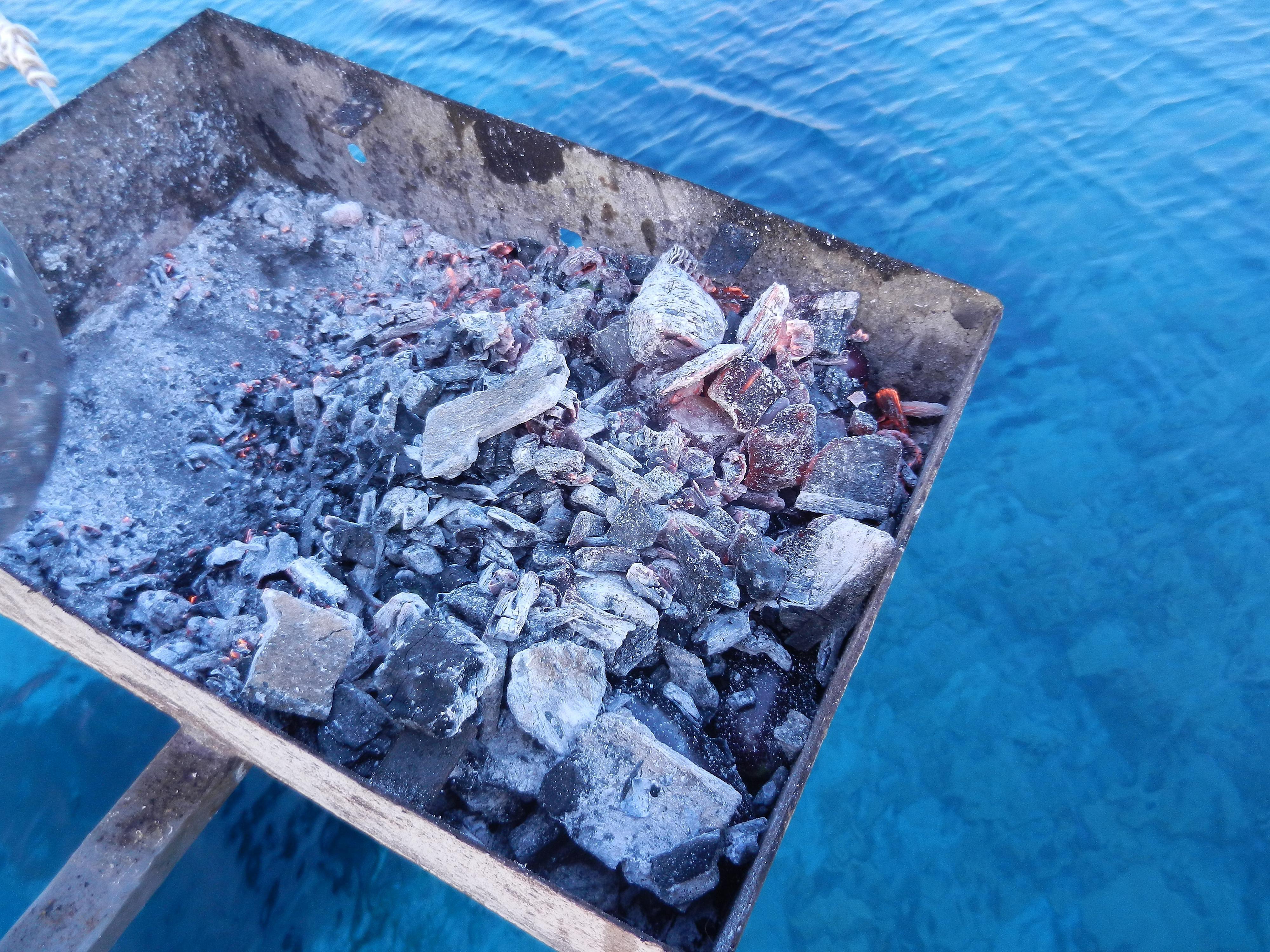 roasting eggplants under charcoal