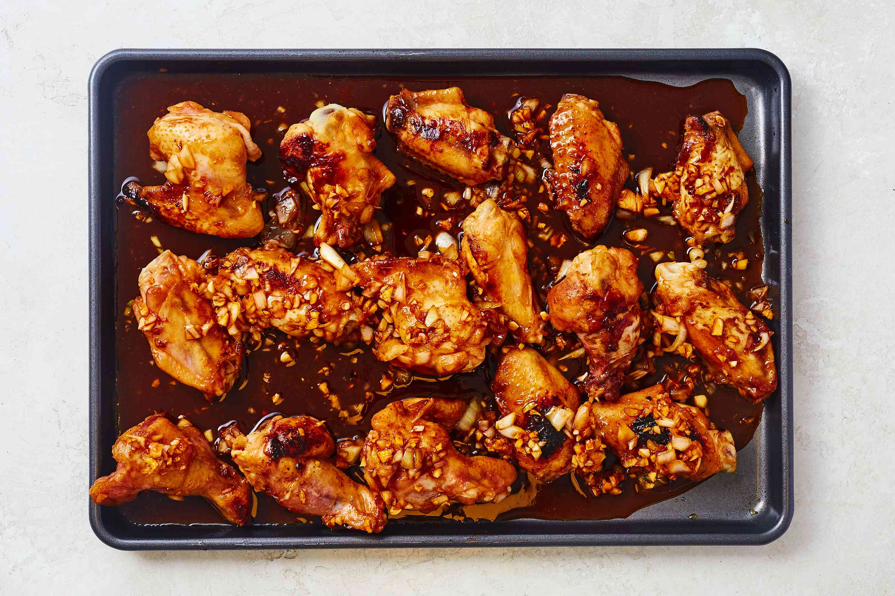 Transfer chicken wings to a baking pan