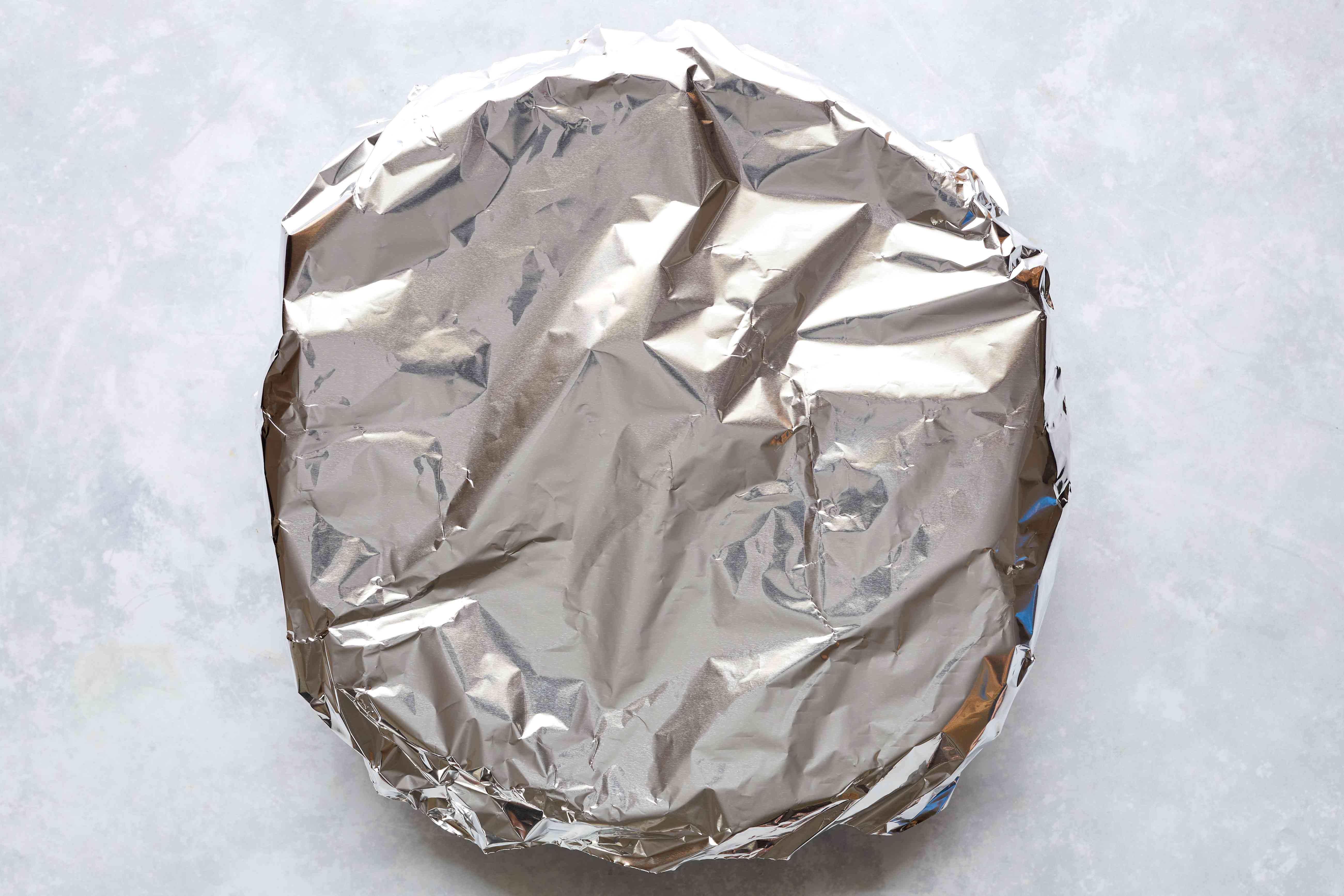 Apple pie covered with aluminum foil