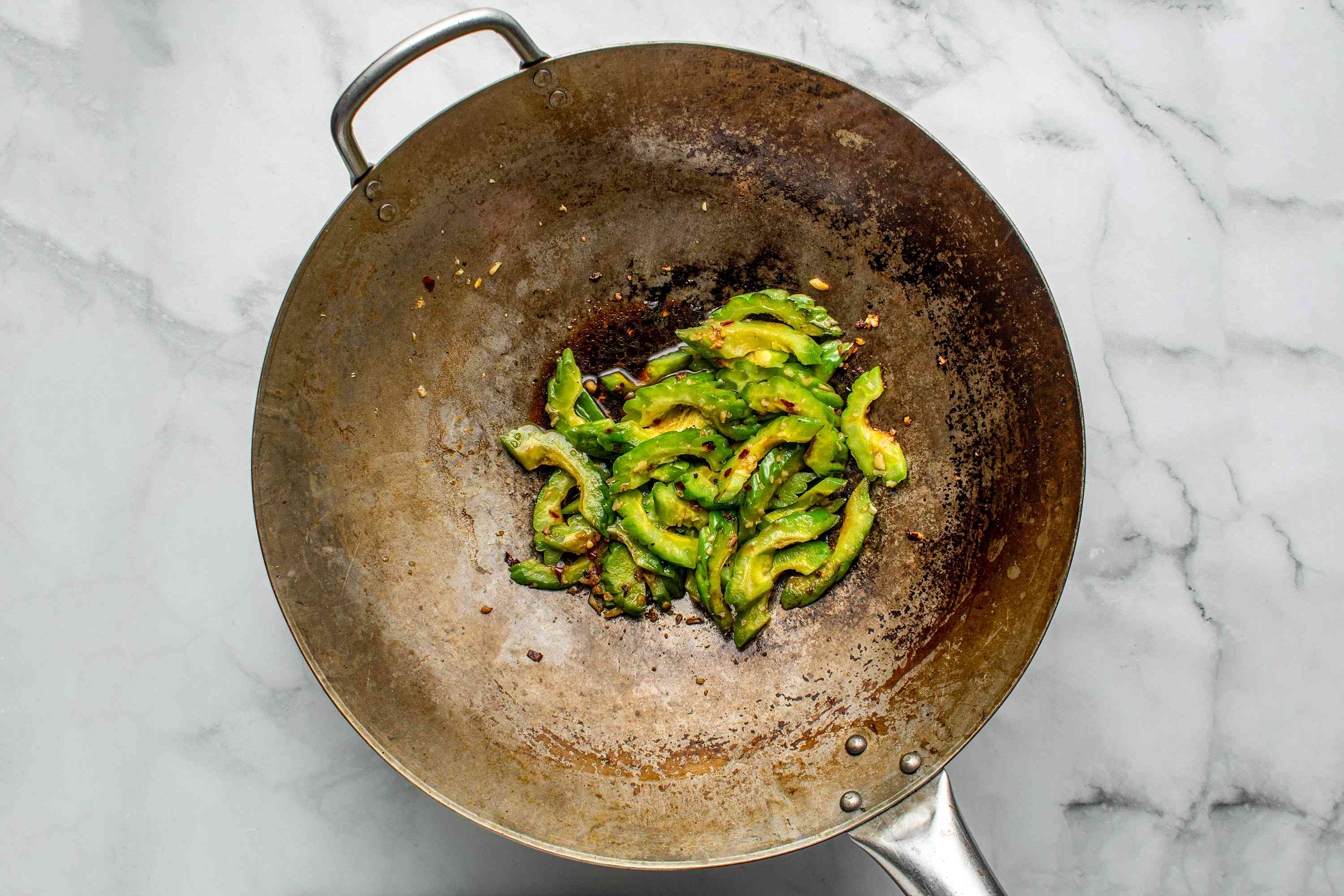 bitter melon cooking in a wok