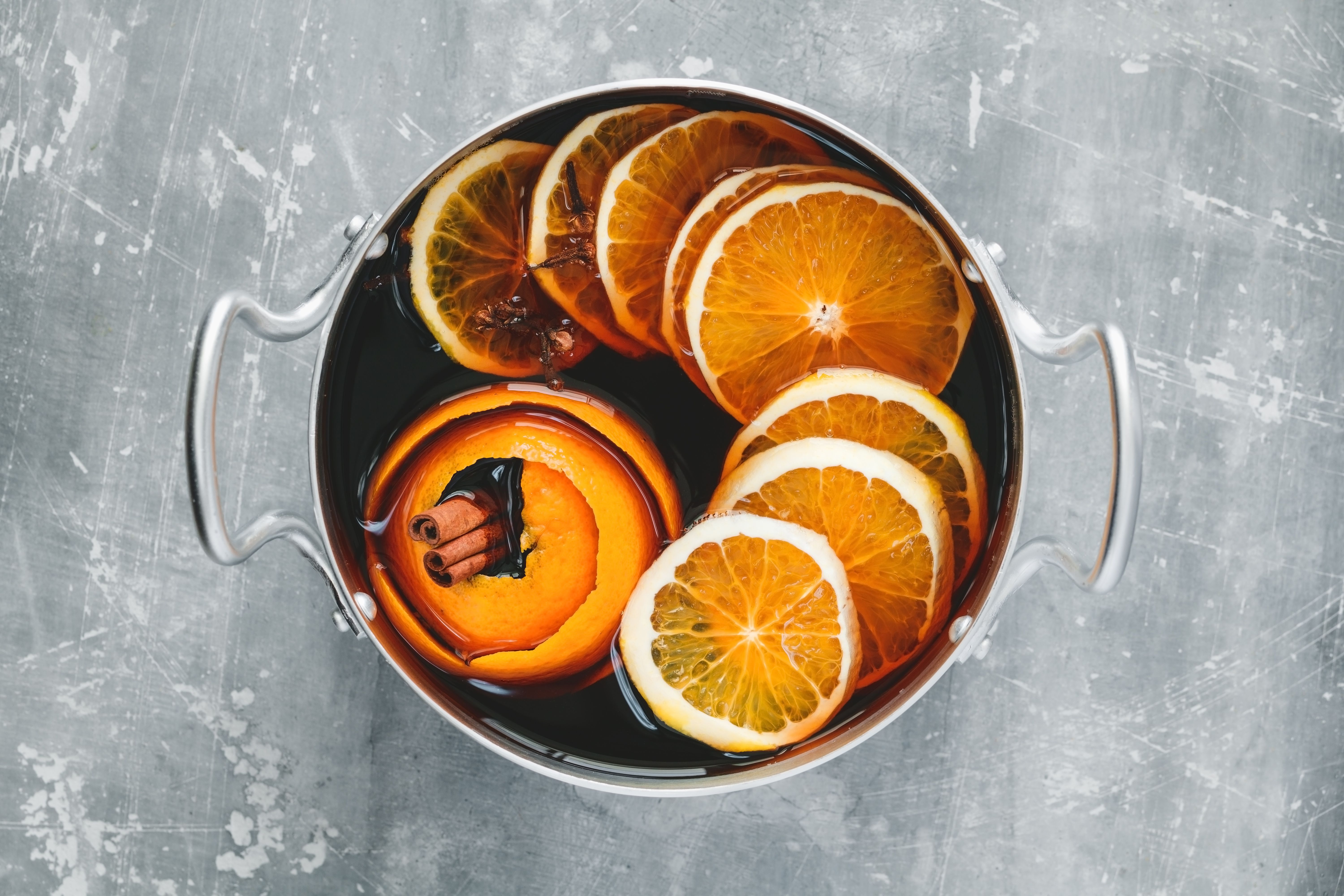 Mulled wine ingredients in a stockpot
