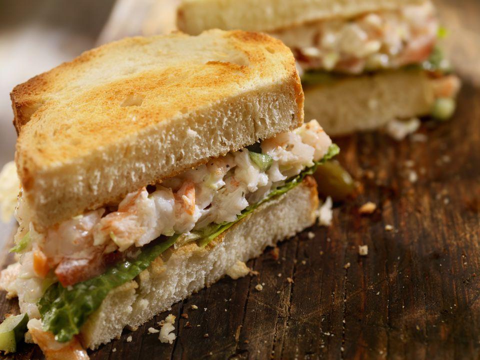 A toasted seafood salad sandwich