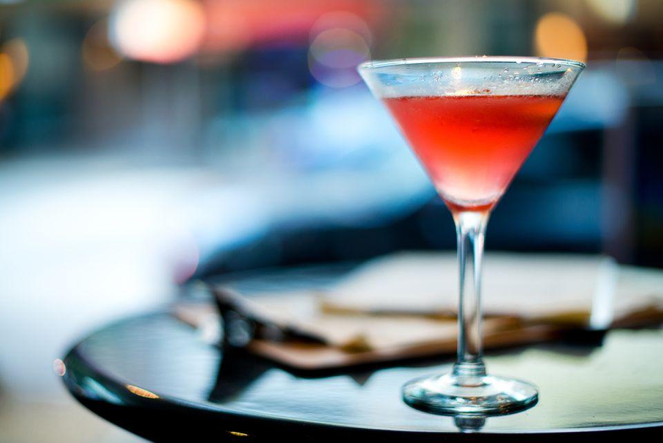 Cocktail with genever, orange & raspberries.