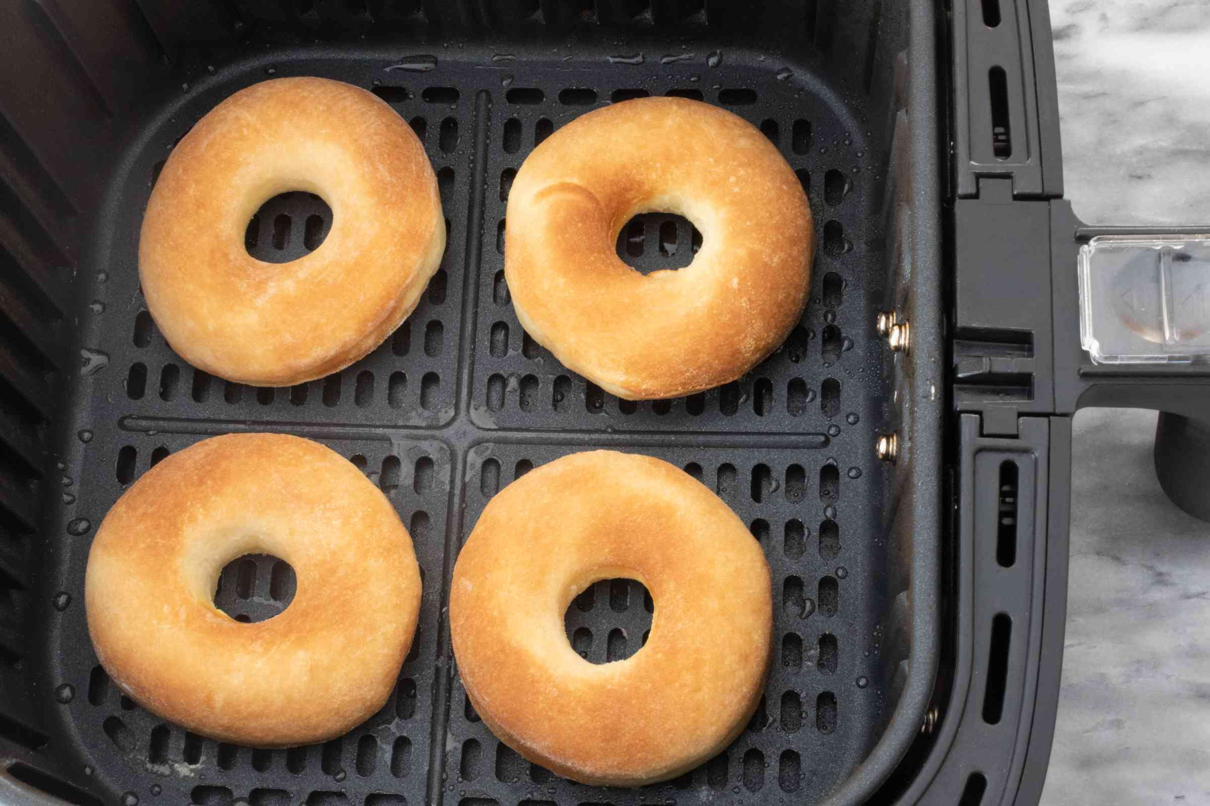 Cooked doughnuts in the air fryer basket