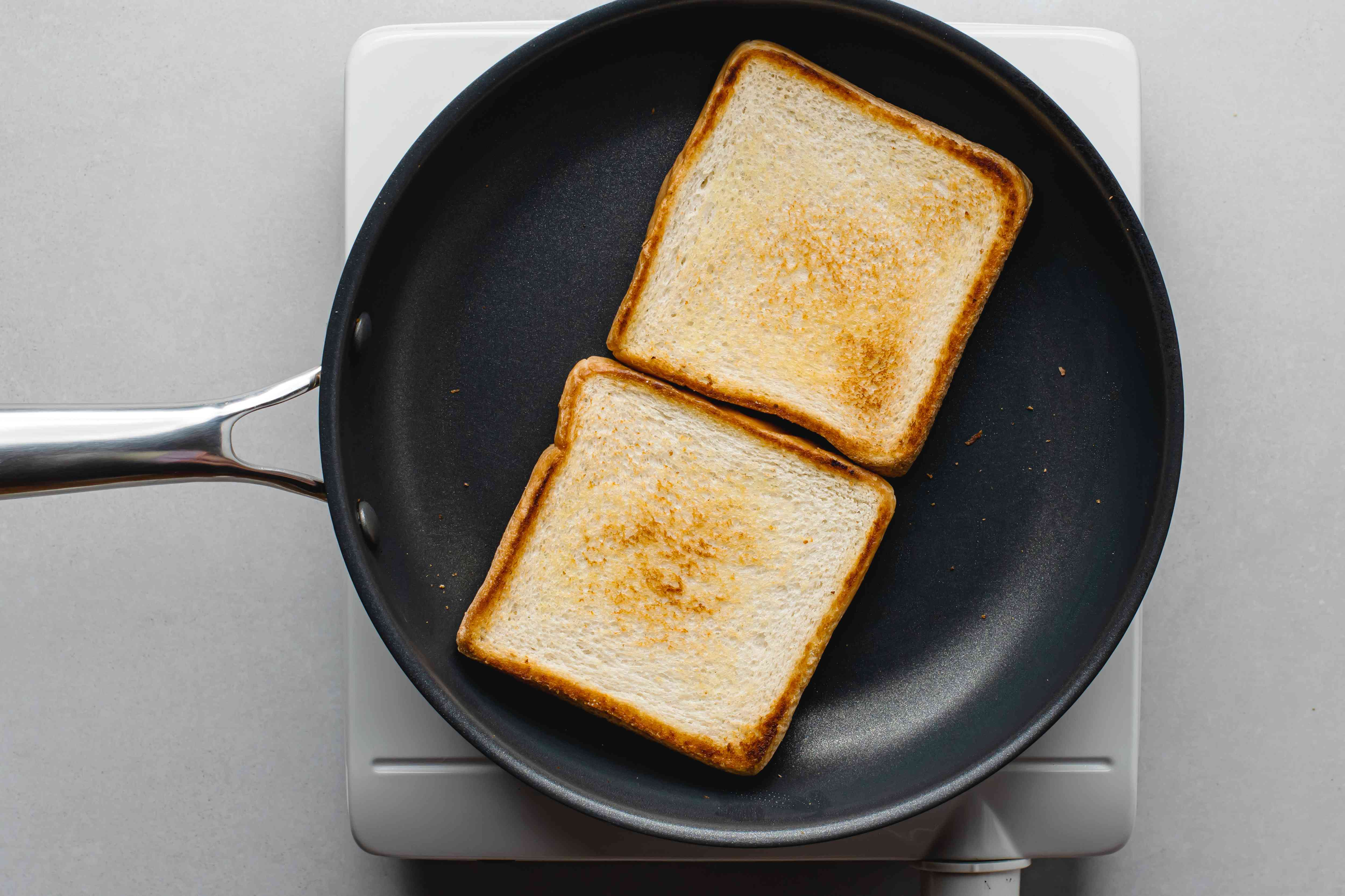 white bread toasted on a skillet