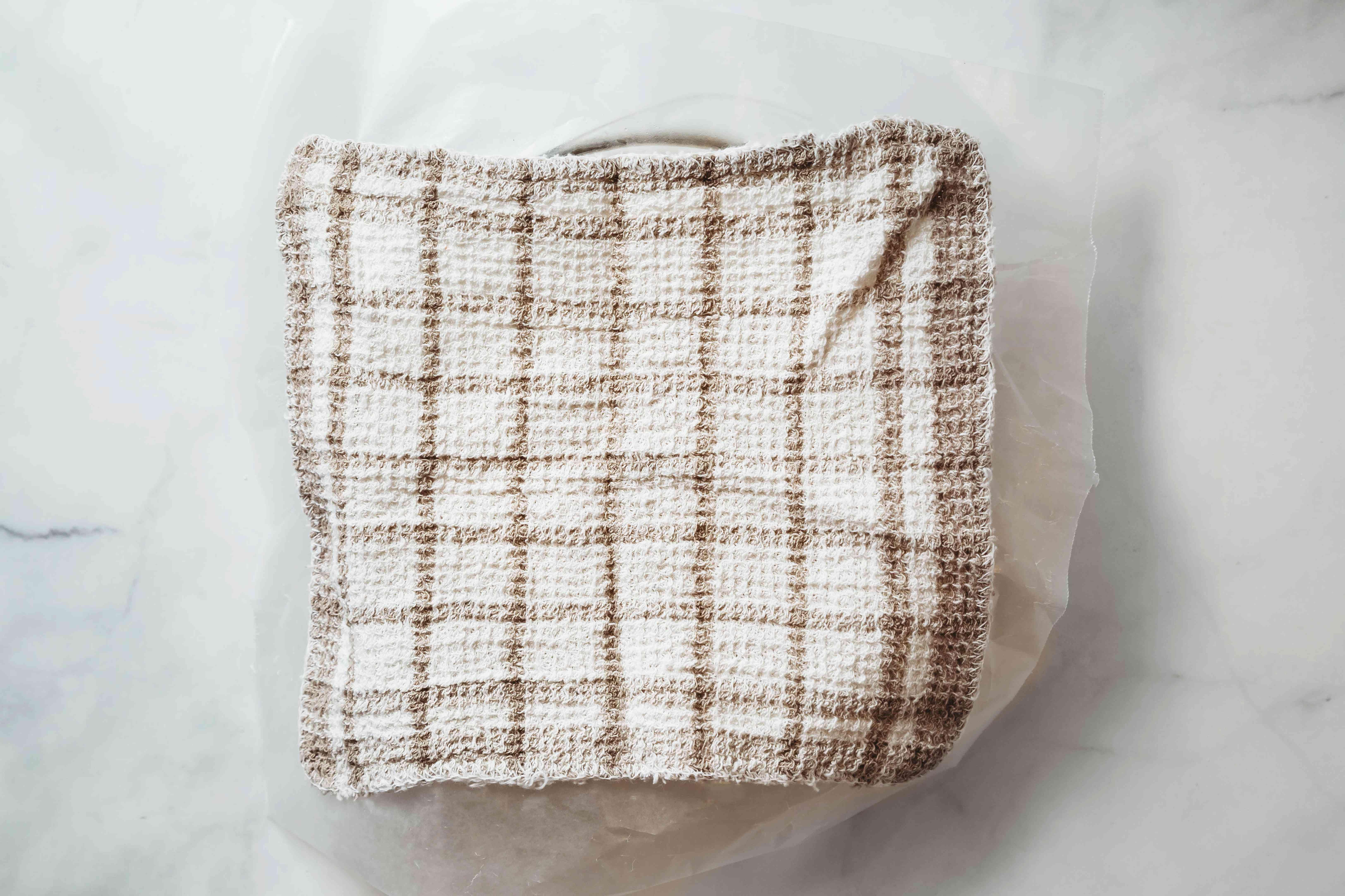 dough resting under a towel