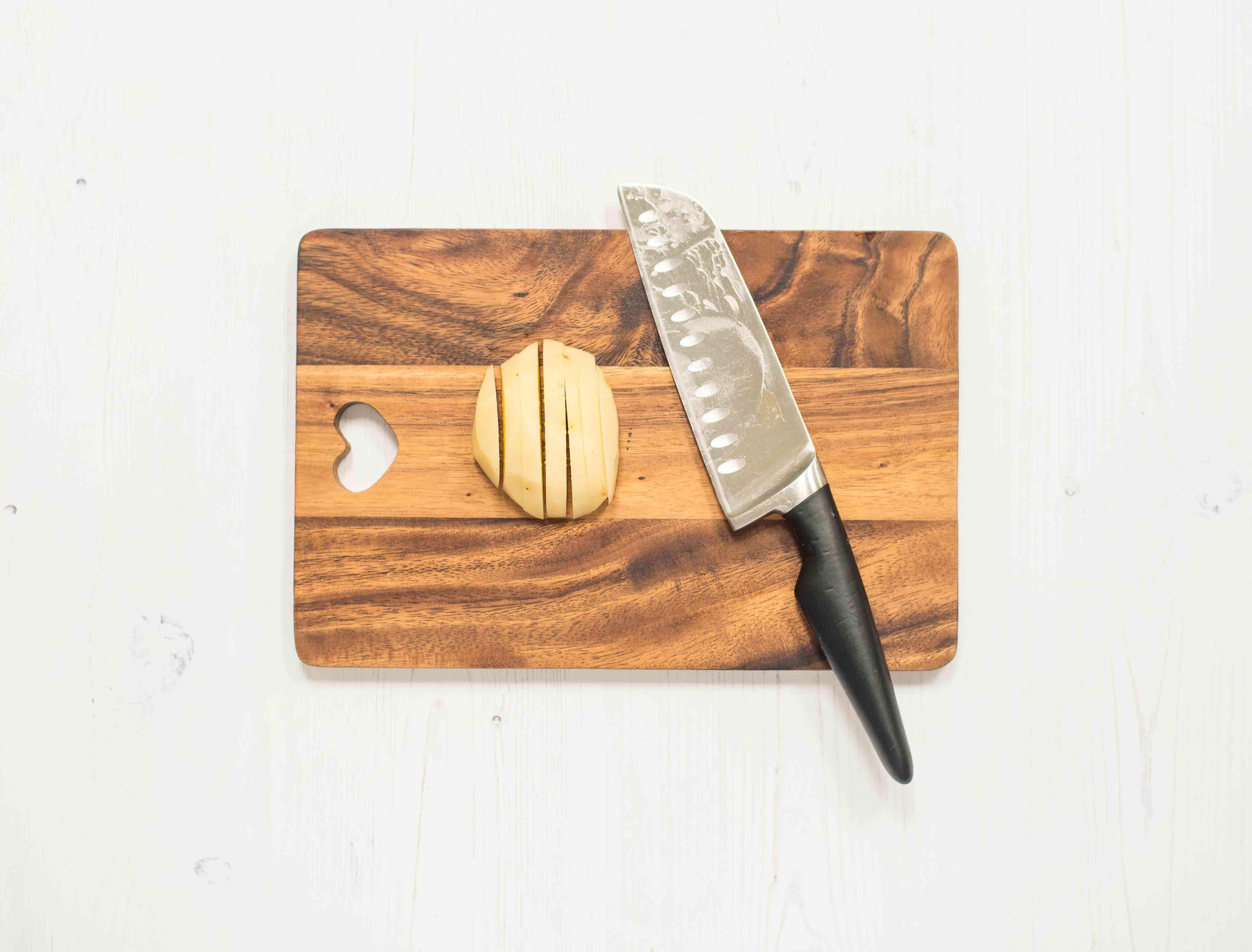 Potato on cutting board