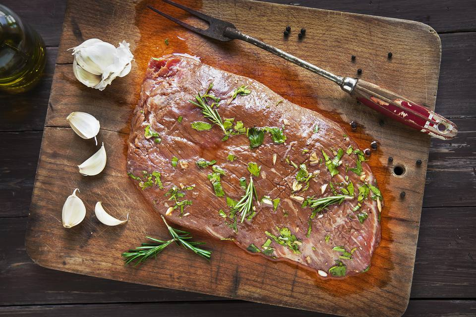 Marinated flank steak with herbs.