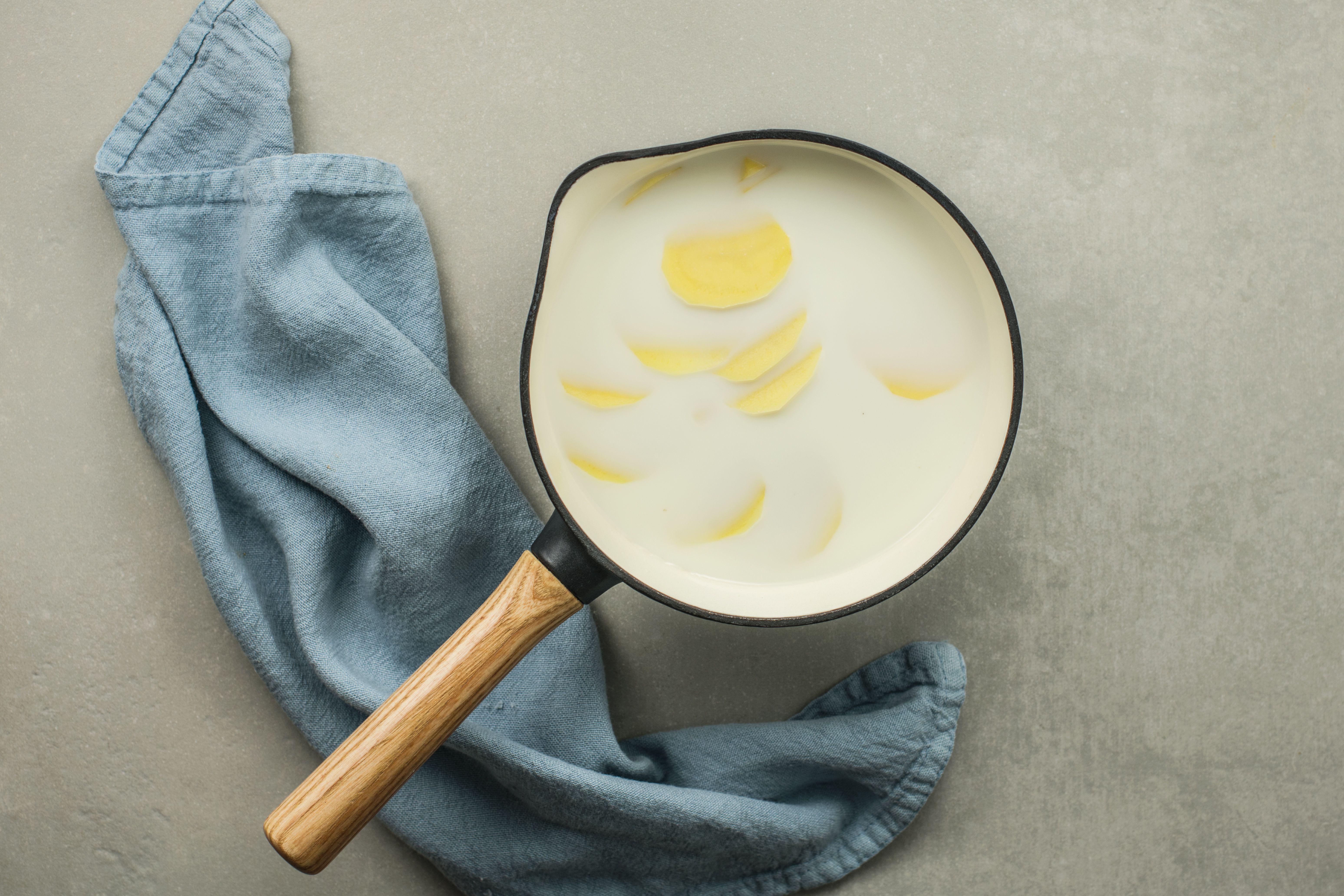 Potatoes and milk in a saucepan