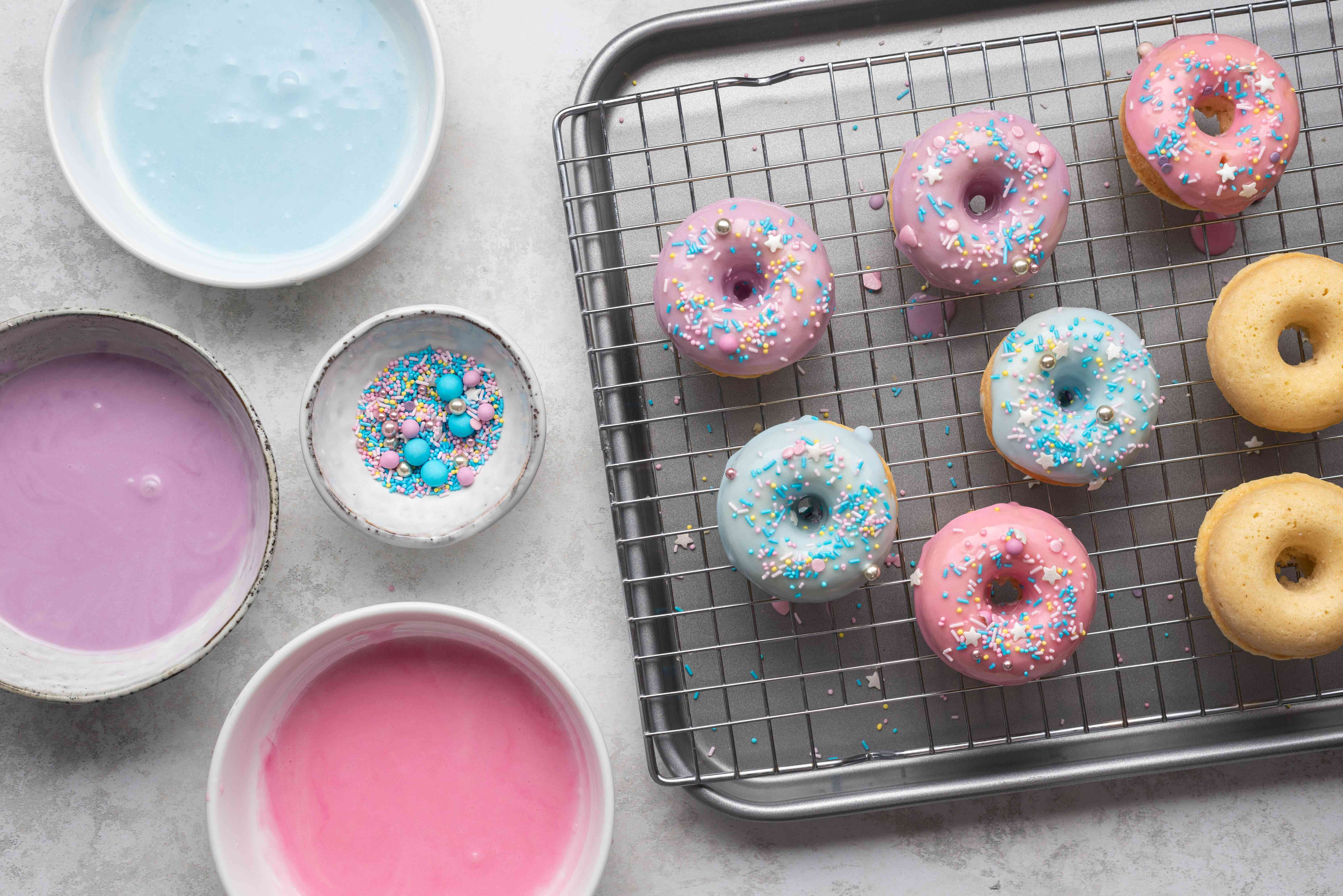 glazed doughnuts with sprinkles on a cooling rack