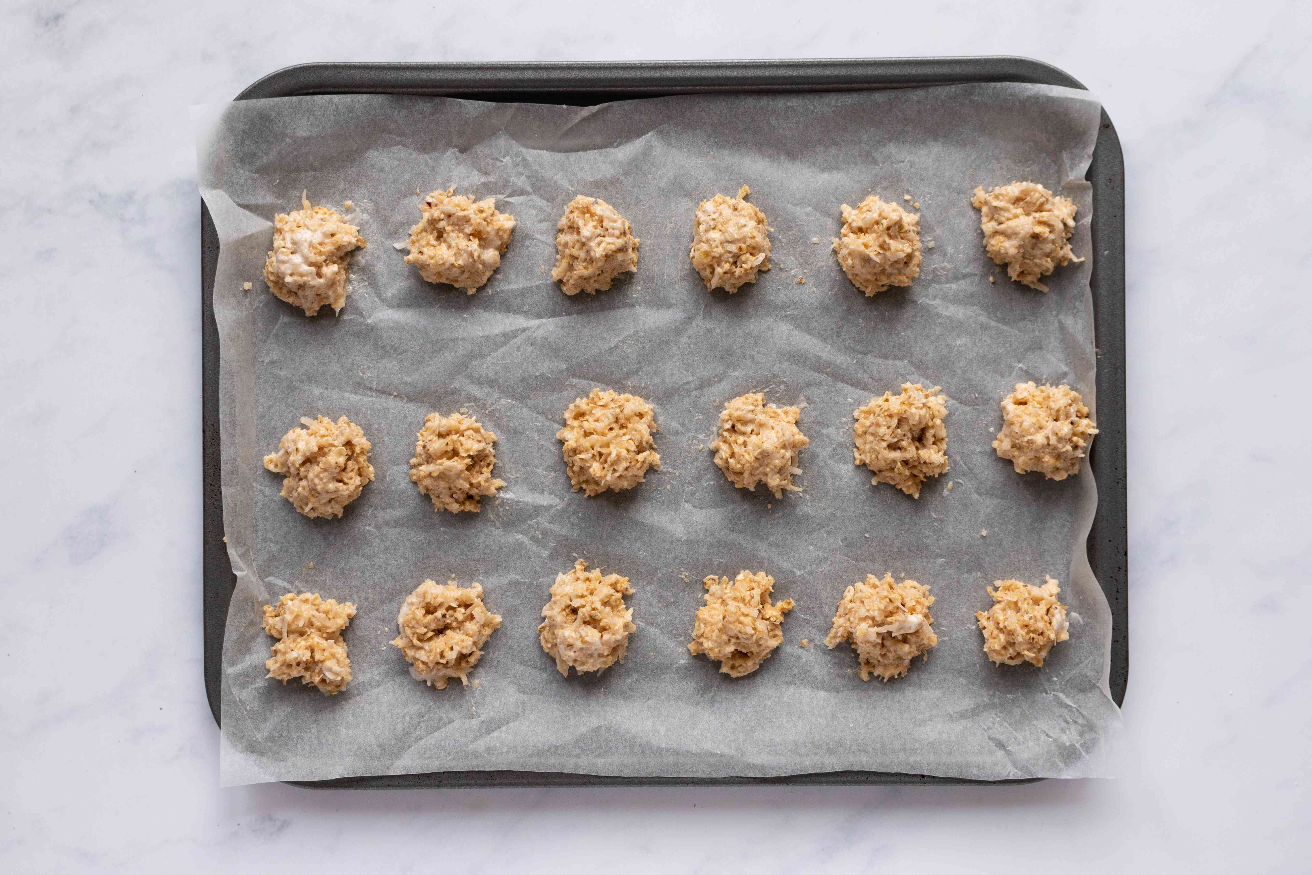 coconut cookies on a baking sheet
