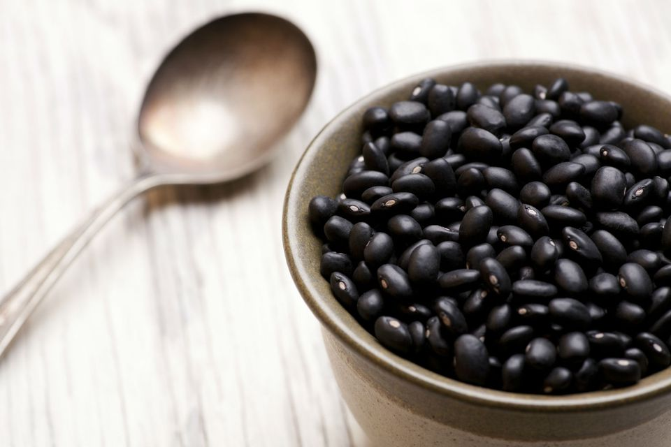 Bowl filled with a large amount of black beans