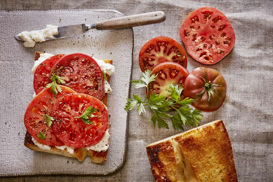 Fresh cut tomatoes with parsley, bread, cheese
