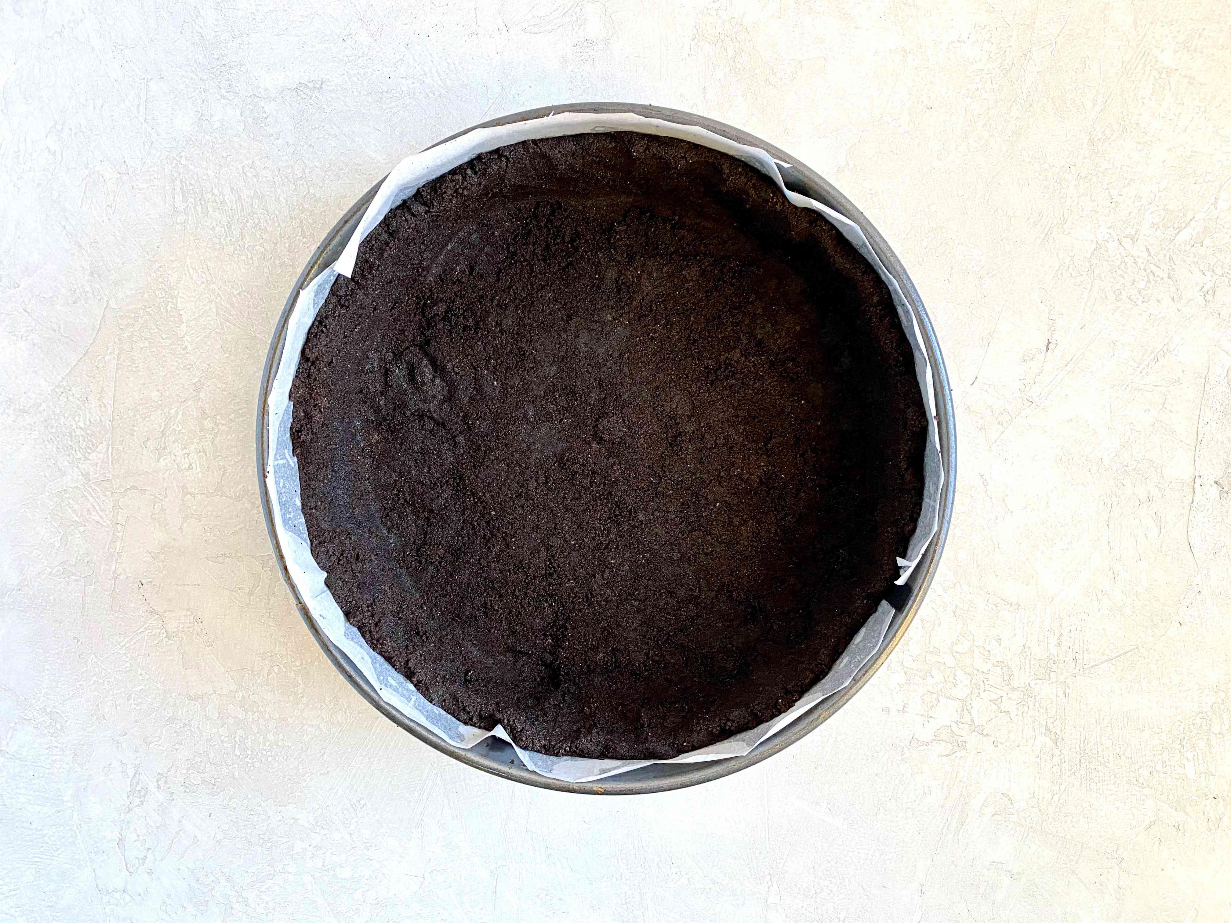 Oreo cookie crust in pan