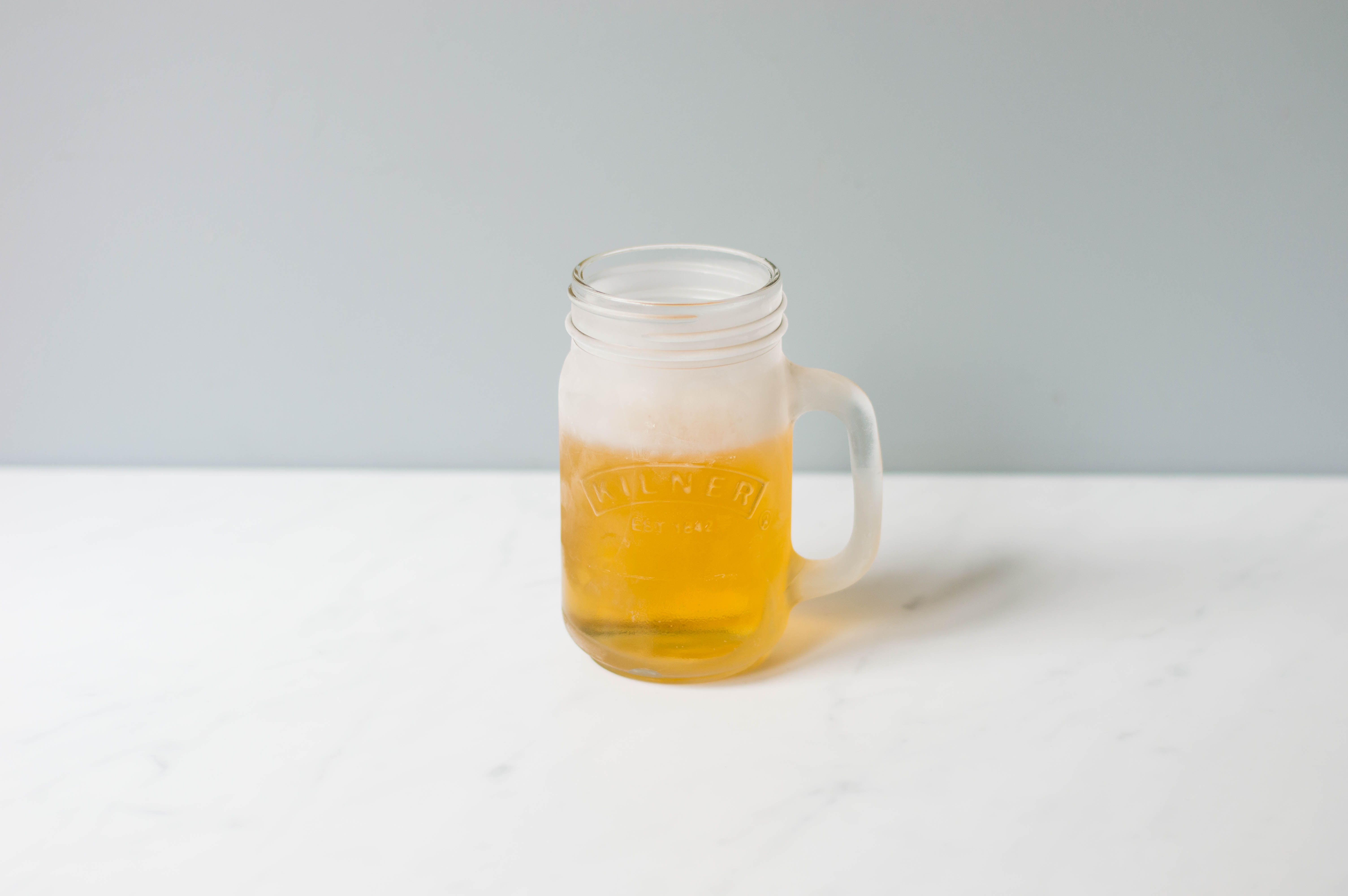 Fill frosty glass 2/3 with cream soda
