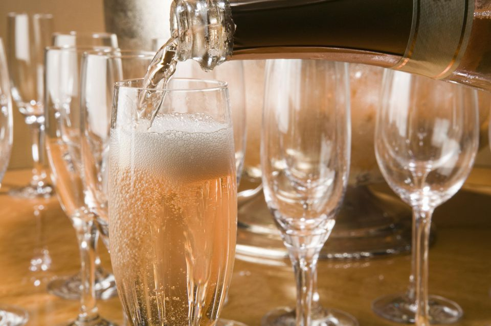 Filling champagne flutes with bubbly