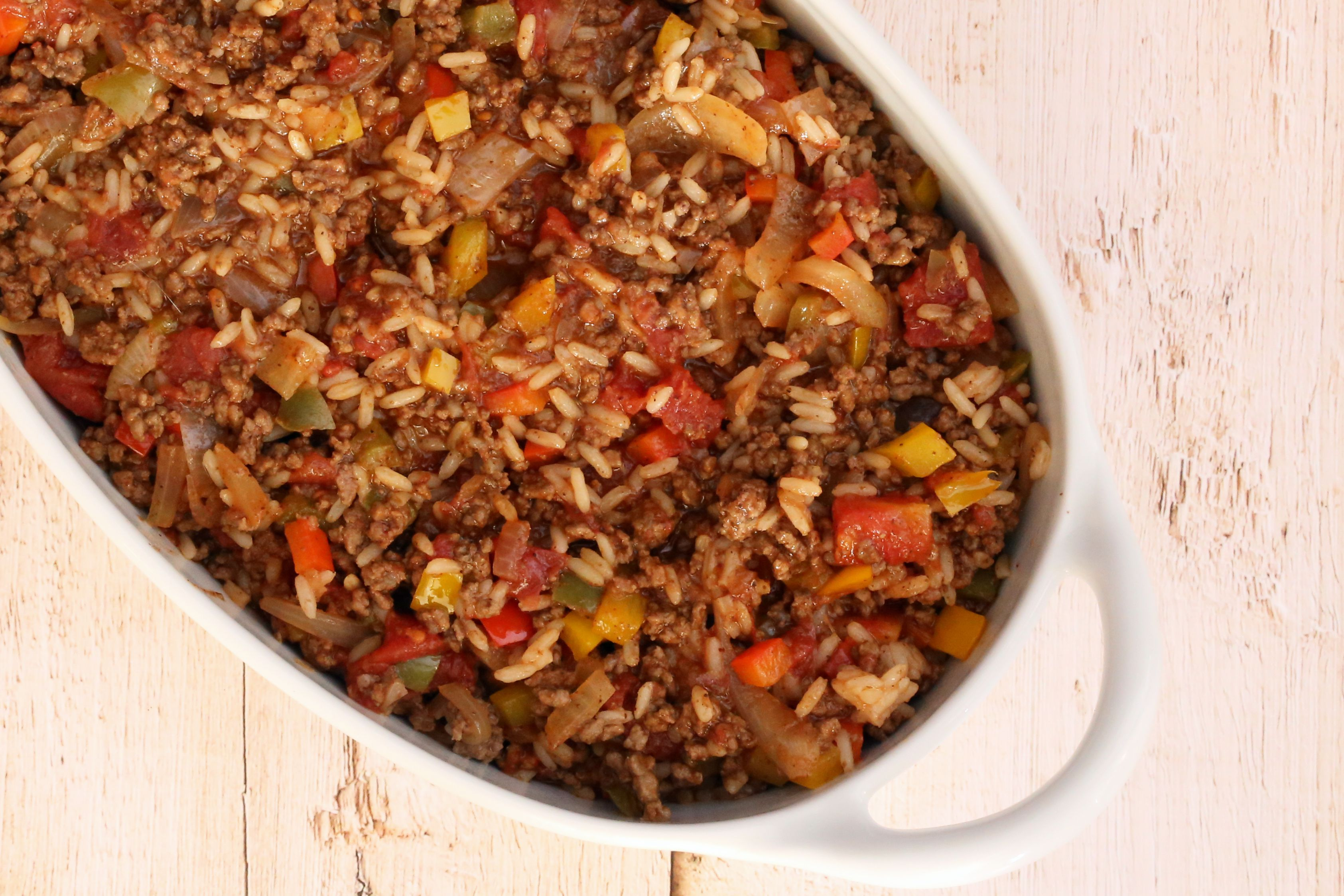 Ground beef and rice in baking dish.