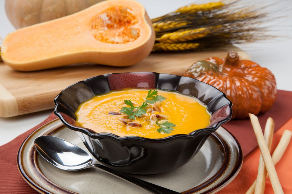 roasted butternut squash soup in bowl with decorations