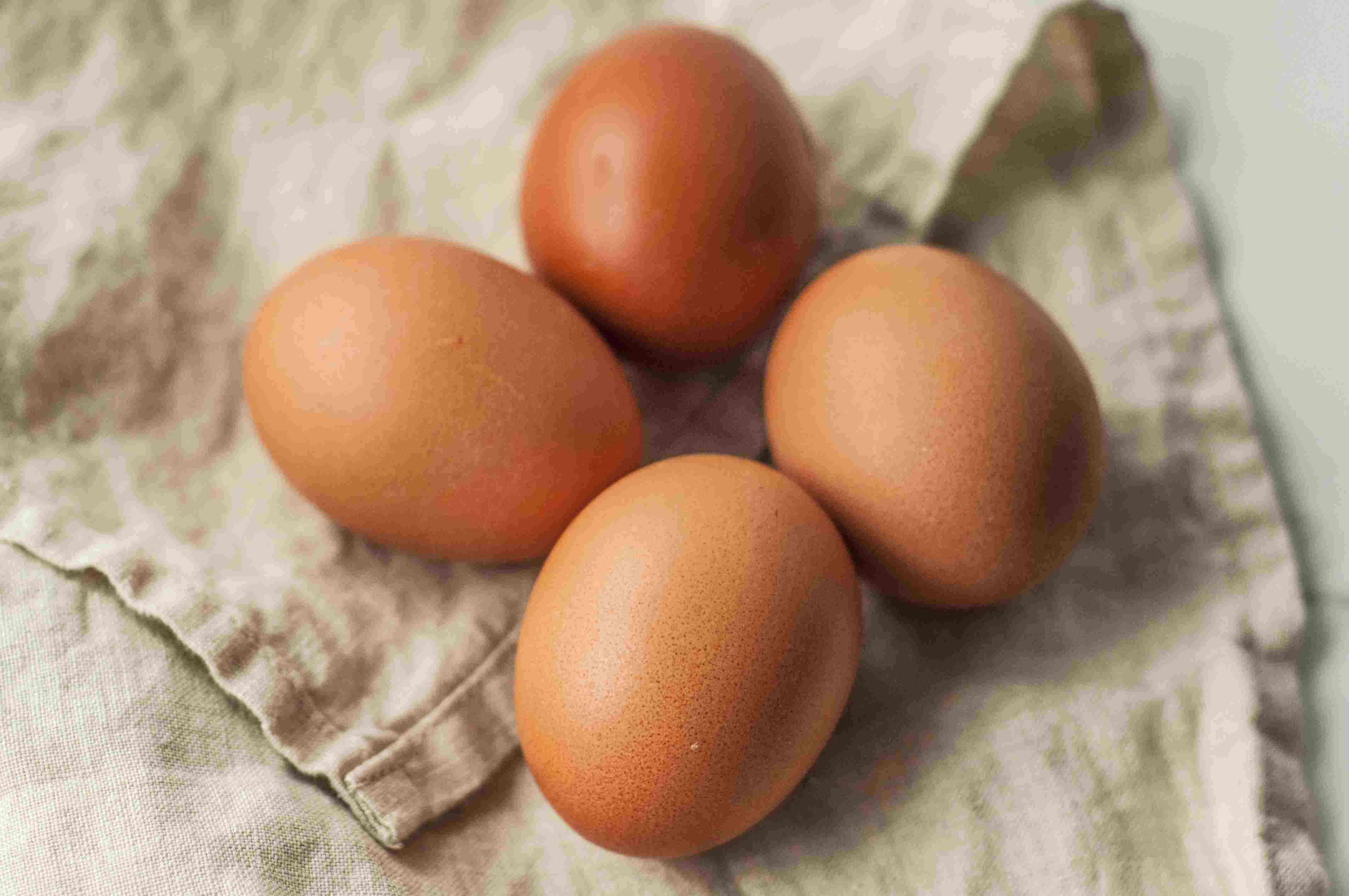 Hard-boiled eggs on a tea towel