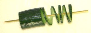 Slicing cucumber for garnish
