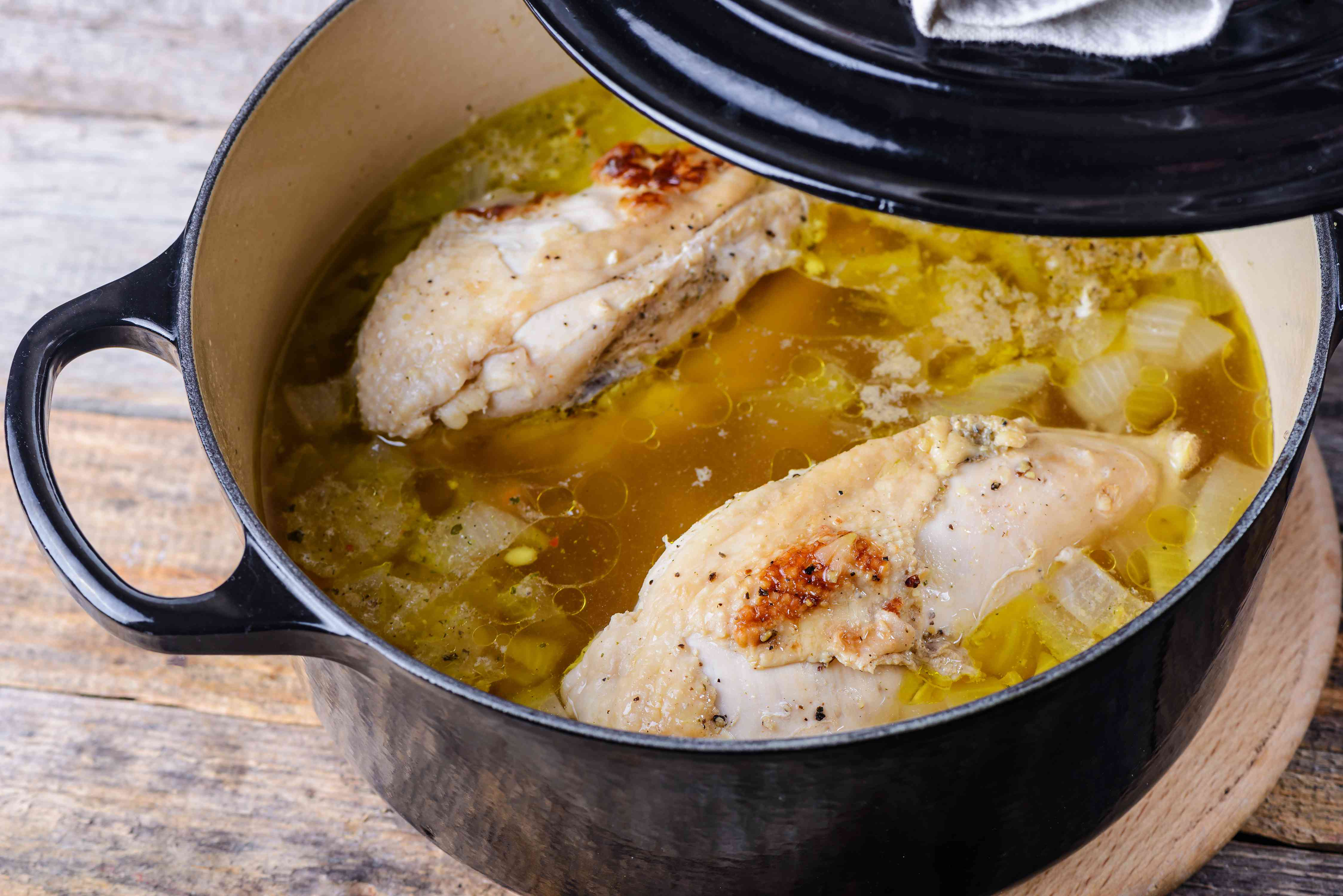 Cooked chicken in the pot with stock