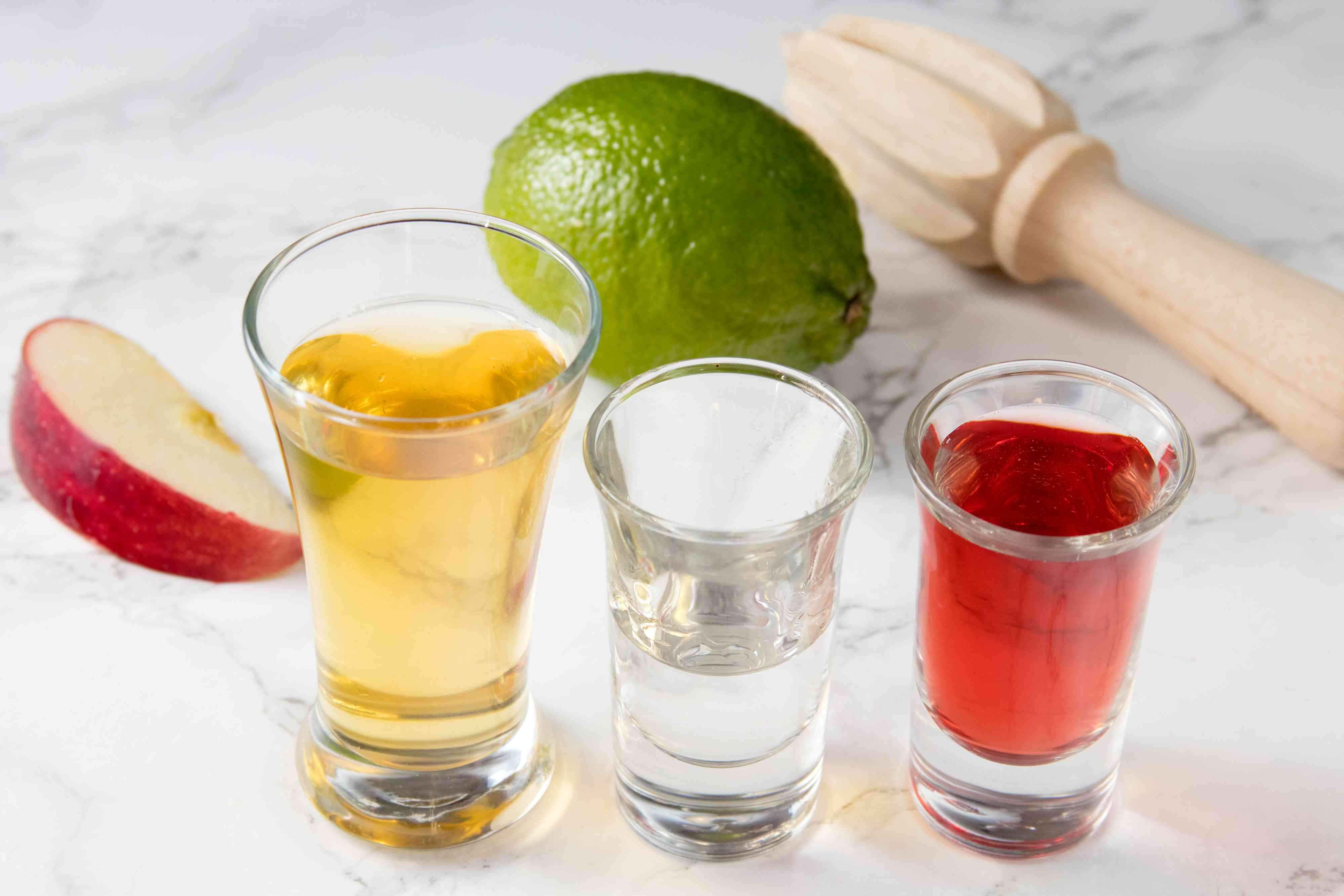 Ingredients for a Cranberry Margarita With Apple-Cinnamon Tequila