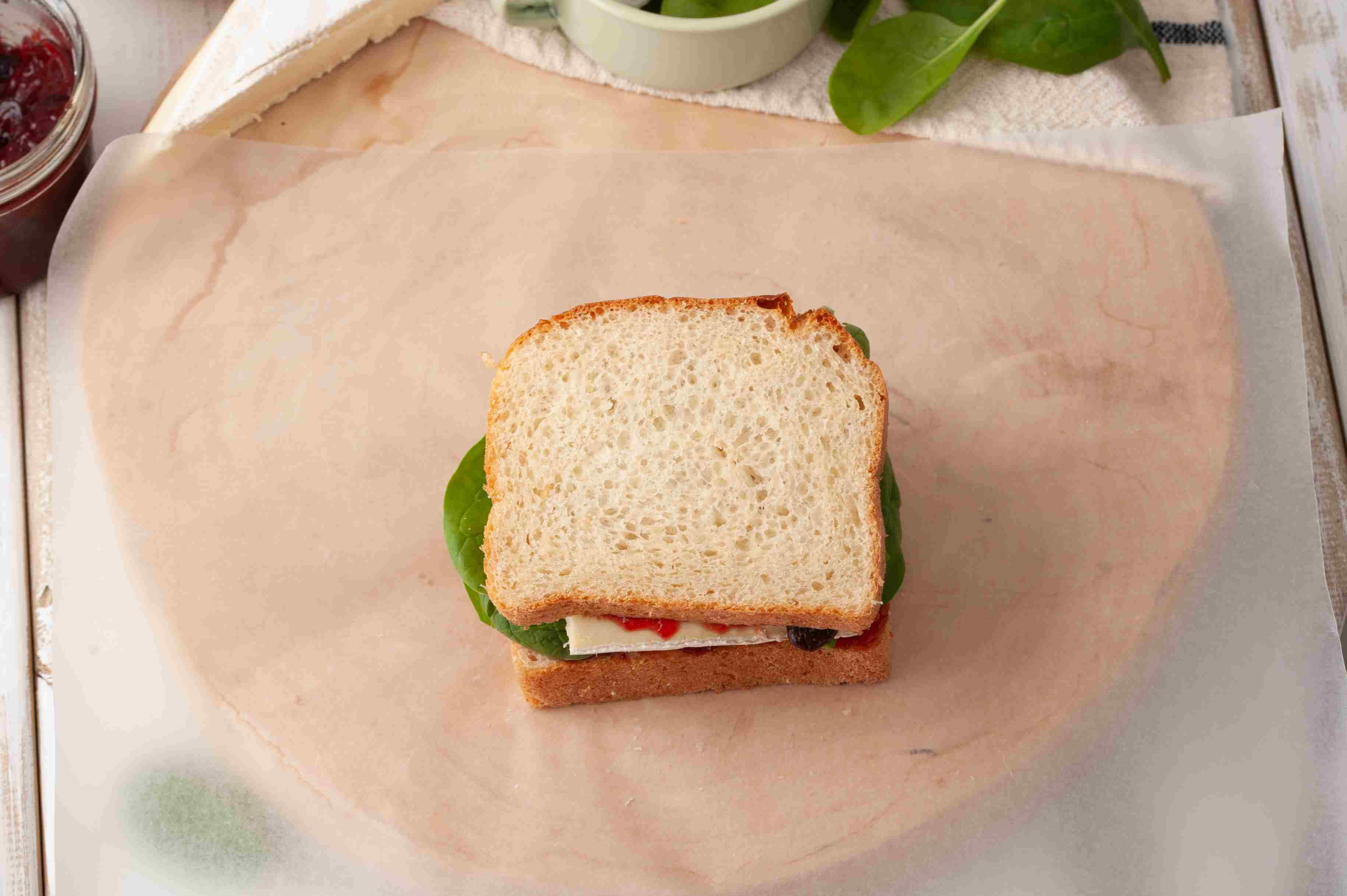 Put sandwich in wax paper