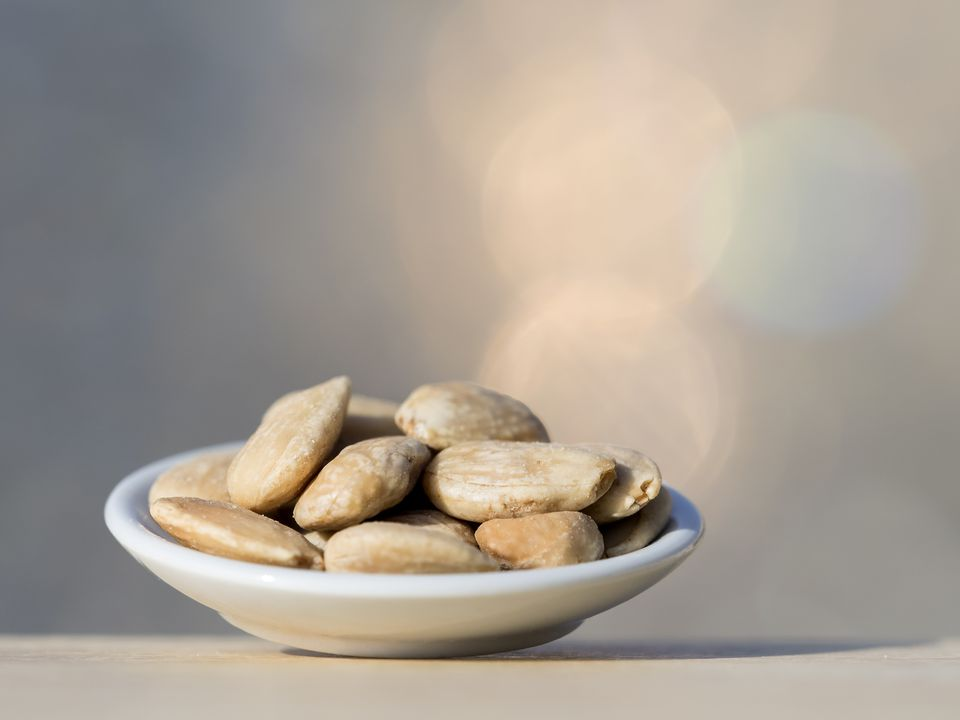 Plate of fried peeled almonds