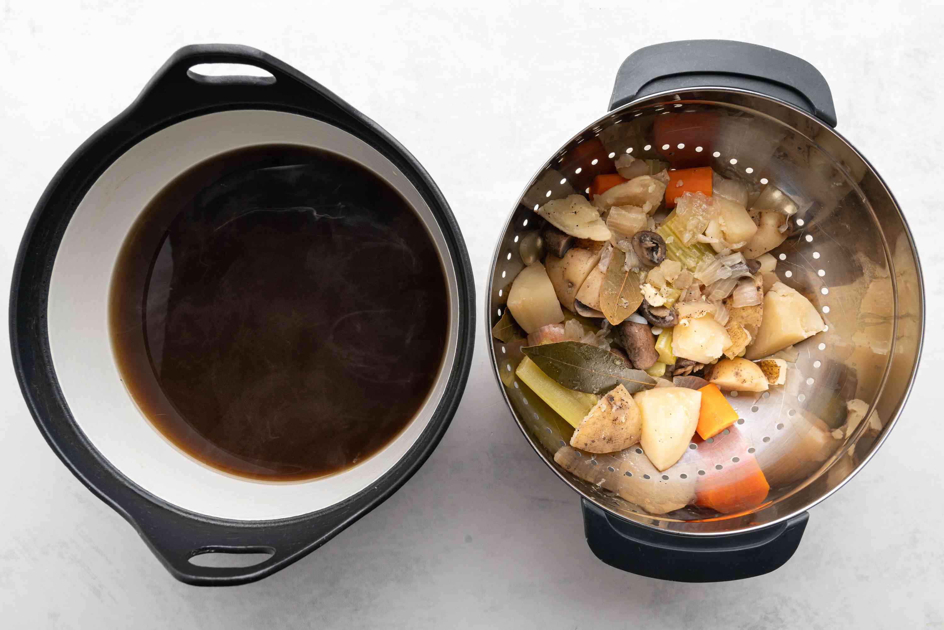 Basic Vegetable Broth in a pot, vegetables strained out of the broth