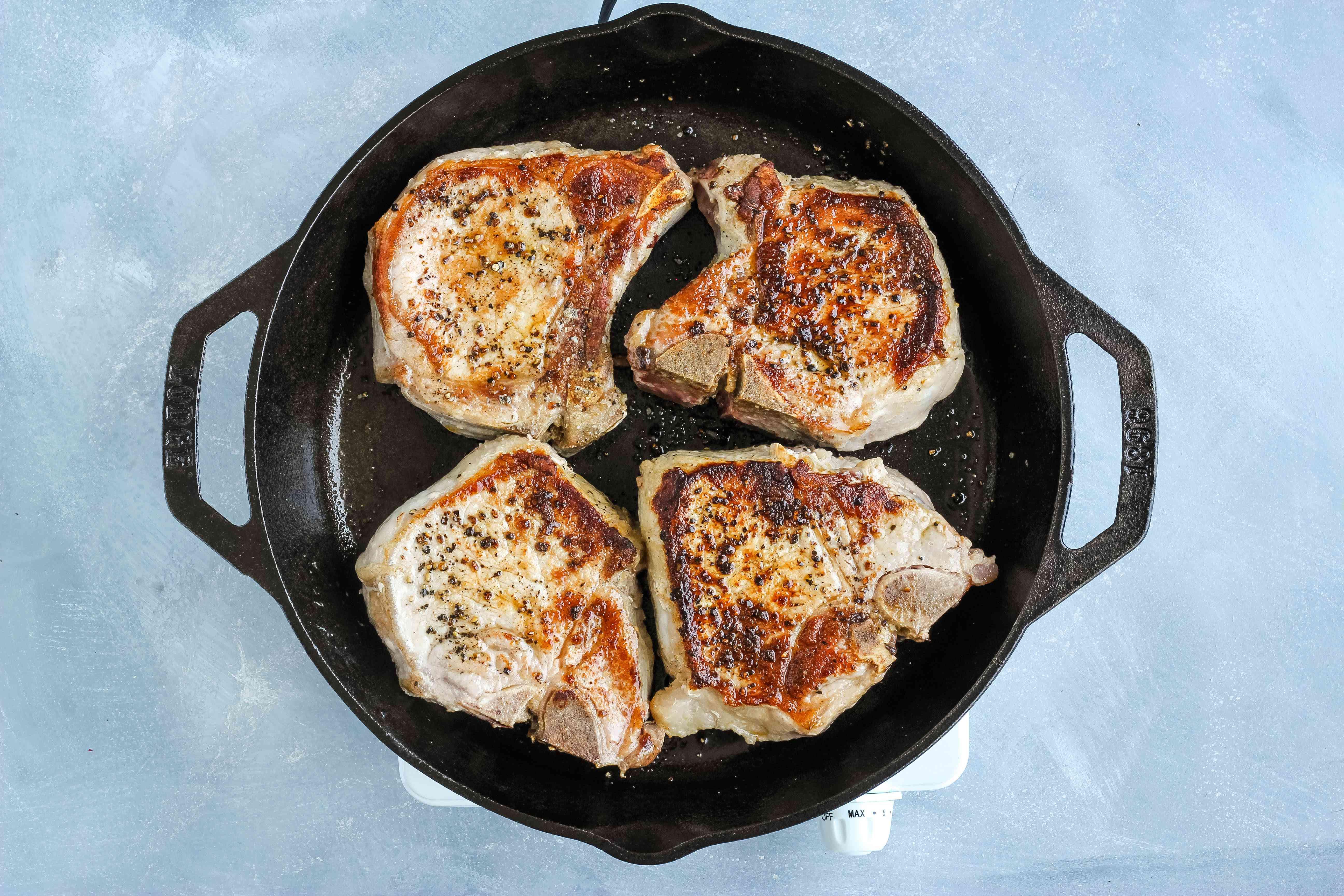 Browned pork chops in the pan