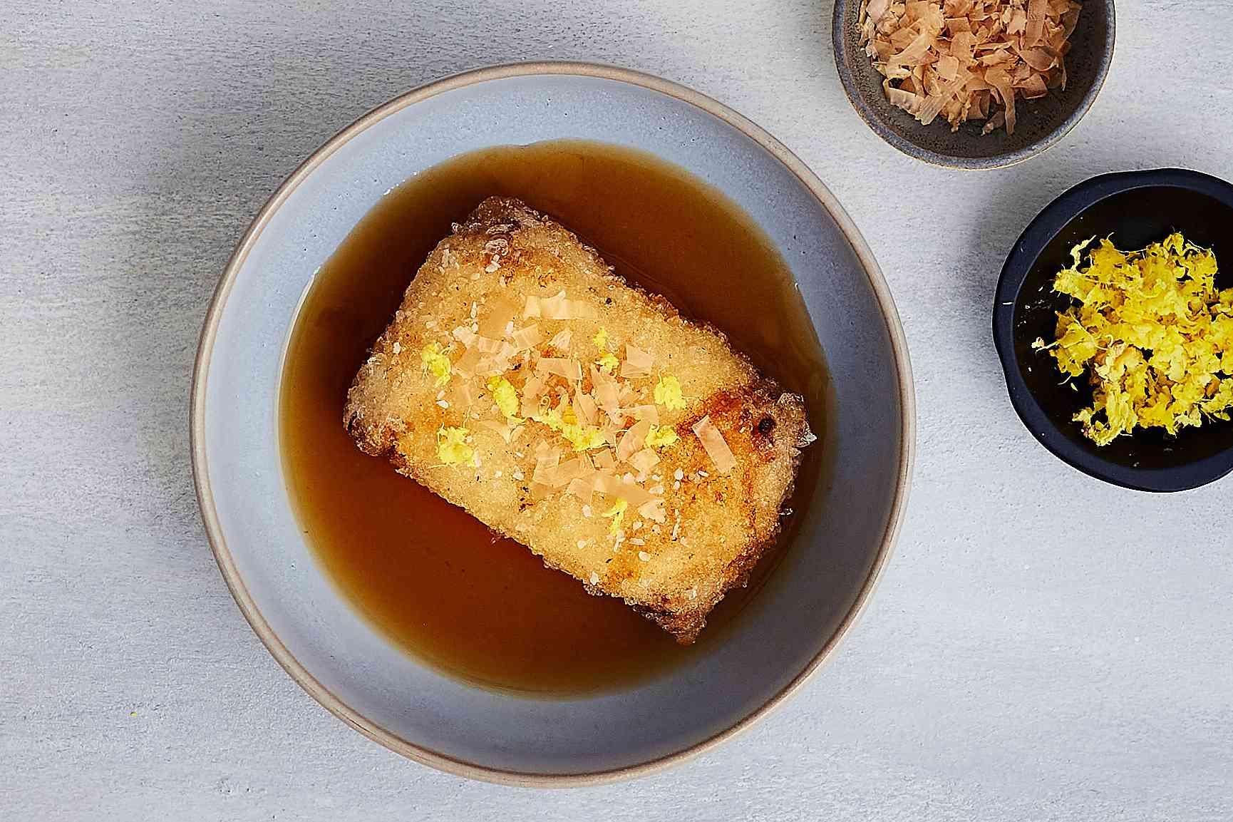 Agedashi Dofu: Japanese Fried Tofu in a Dashi-Based Sauce, garnished with grated ginger and bonito flakes