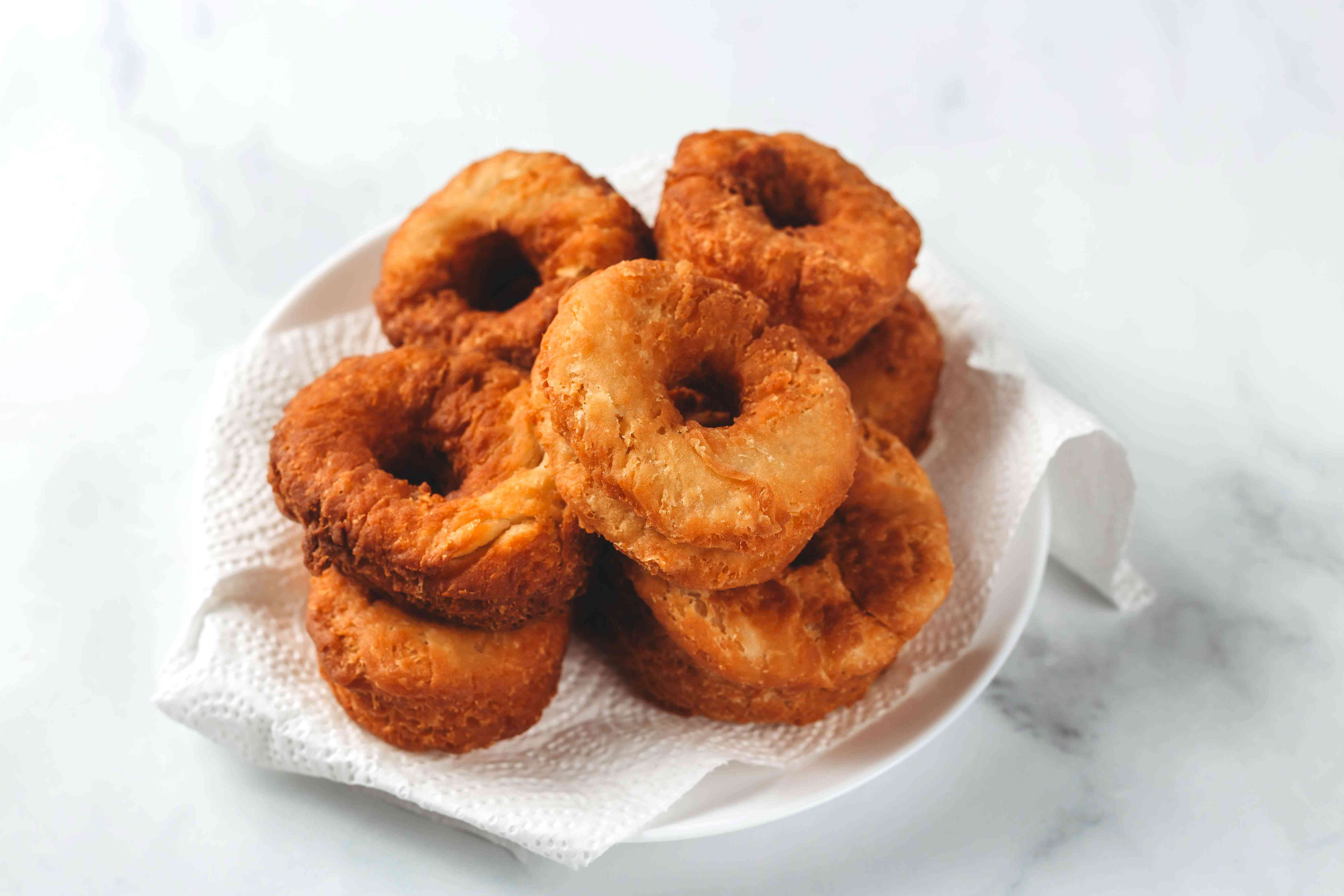 fried Cronuts on a paper towel