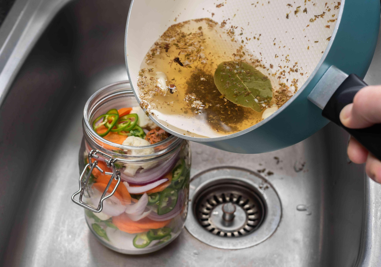 pour the vinegar mixture over the vegetables