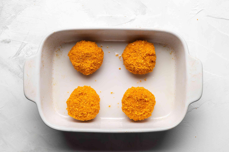 Doritos crusted Babybels arrange in pan