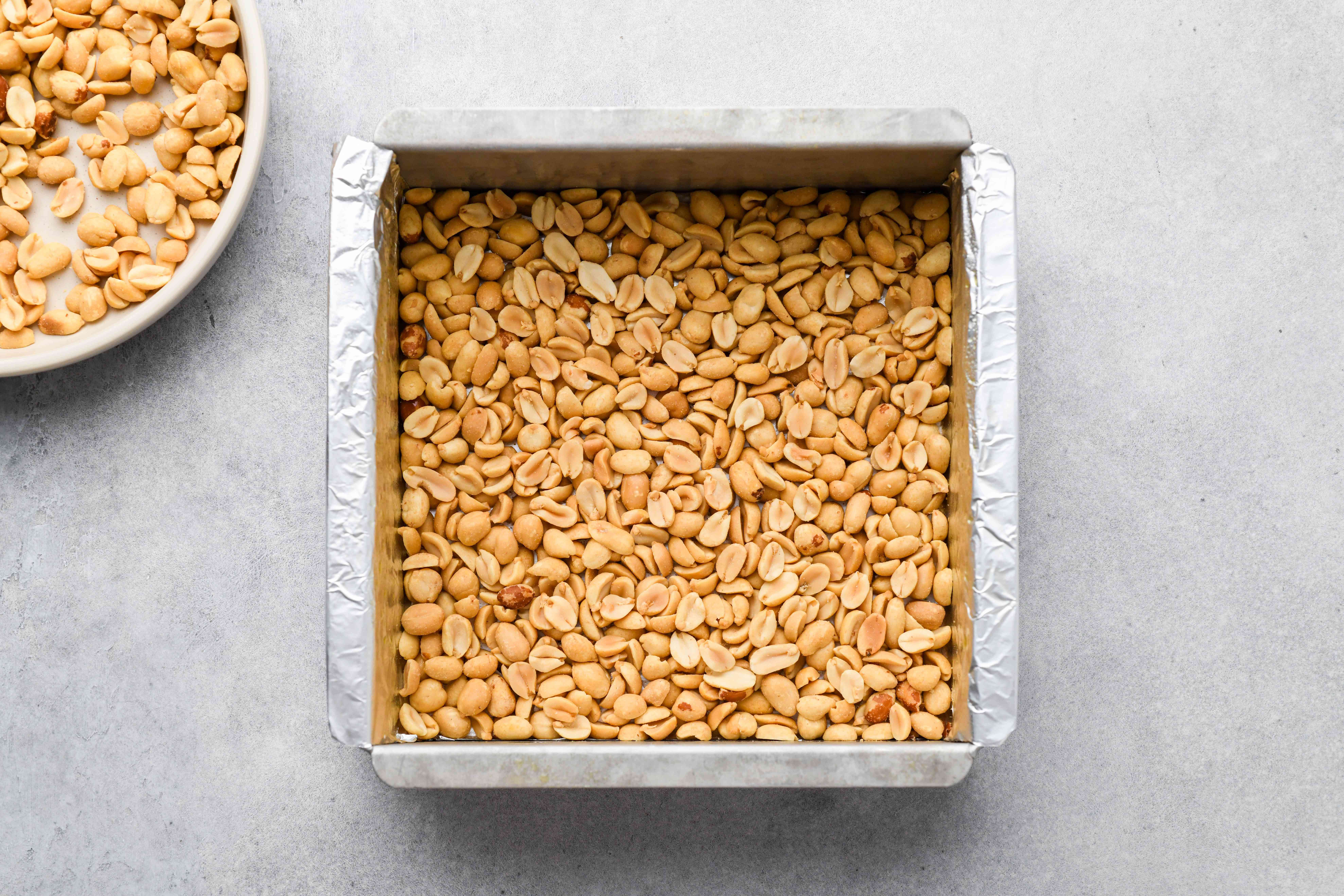 peanuts on in a baking pan
