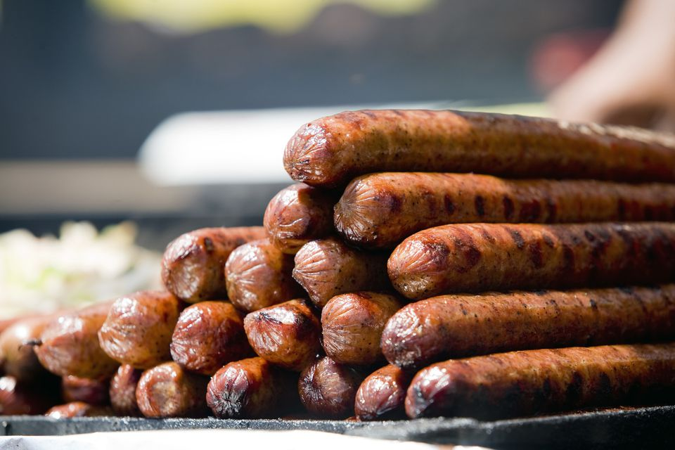 A stack of grilled kielbasa sausages ready to eat